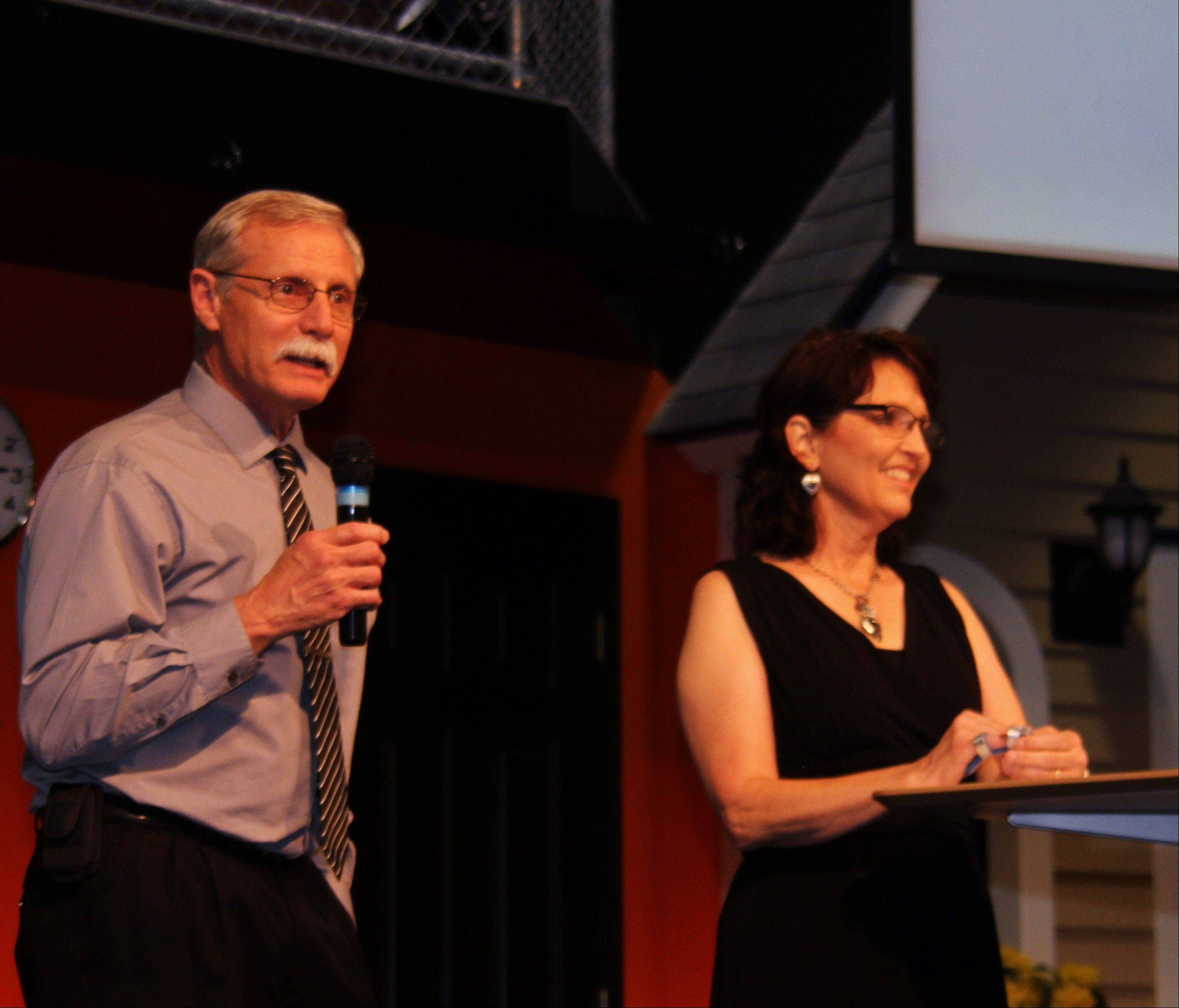 John and Judy Prim address guests at a recent fundraiser at a church in Elk Grove Village, telling them of their dream to build a school and expand their residential program.