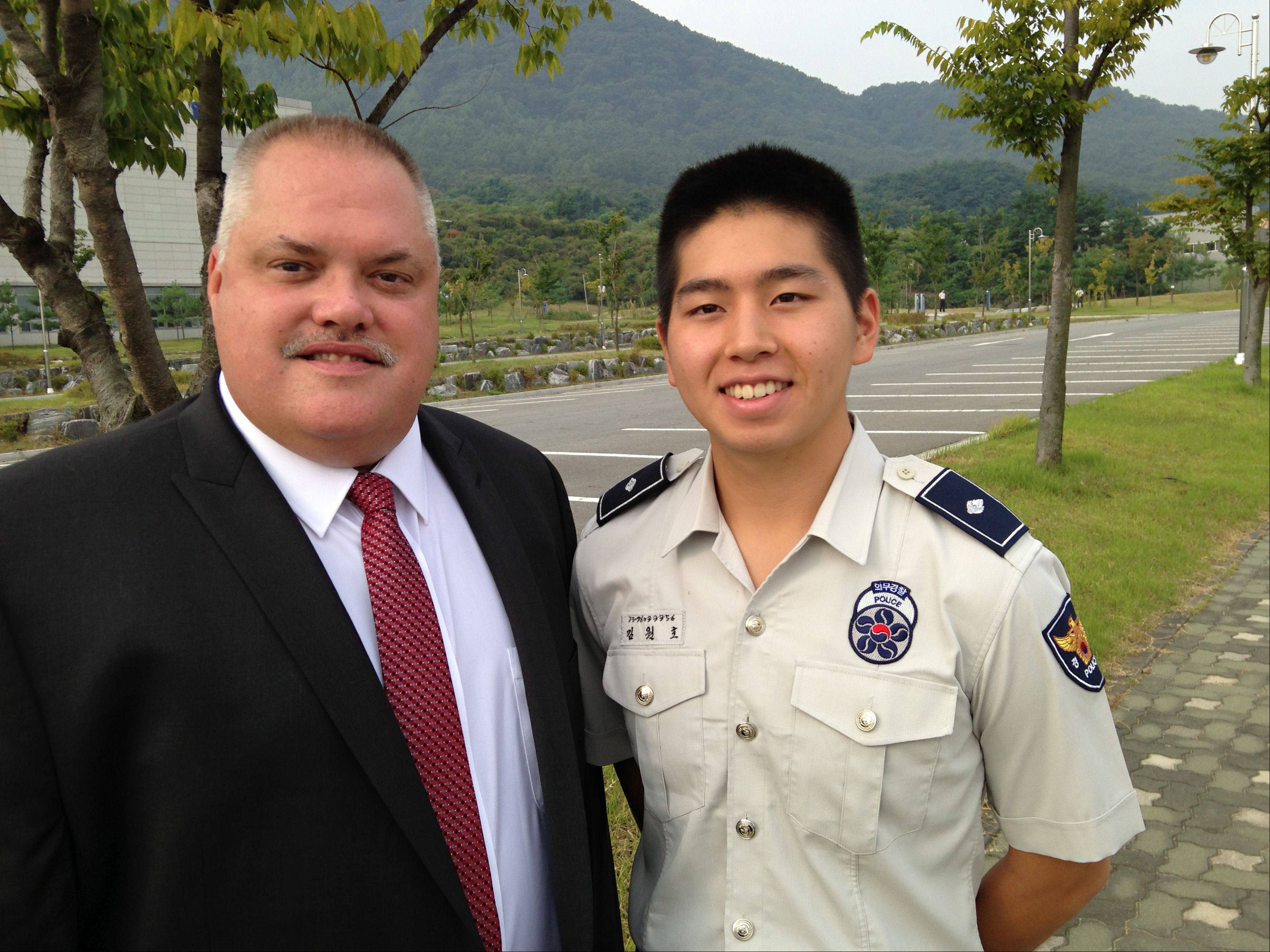 Elgin Police Department Sgt. Jim Lullo in South Korea with translator Jung Kim.