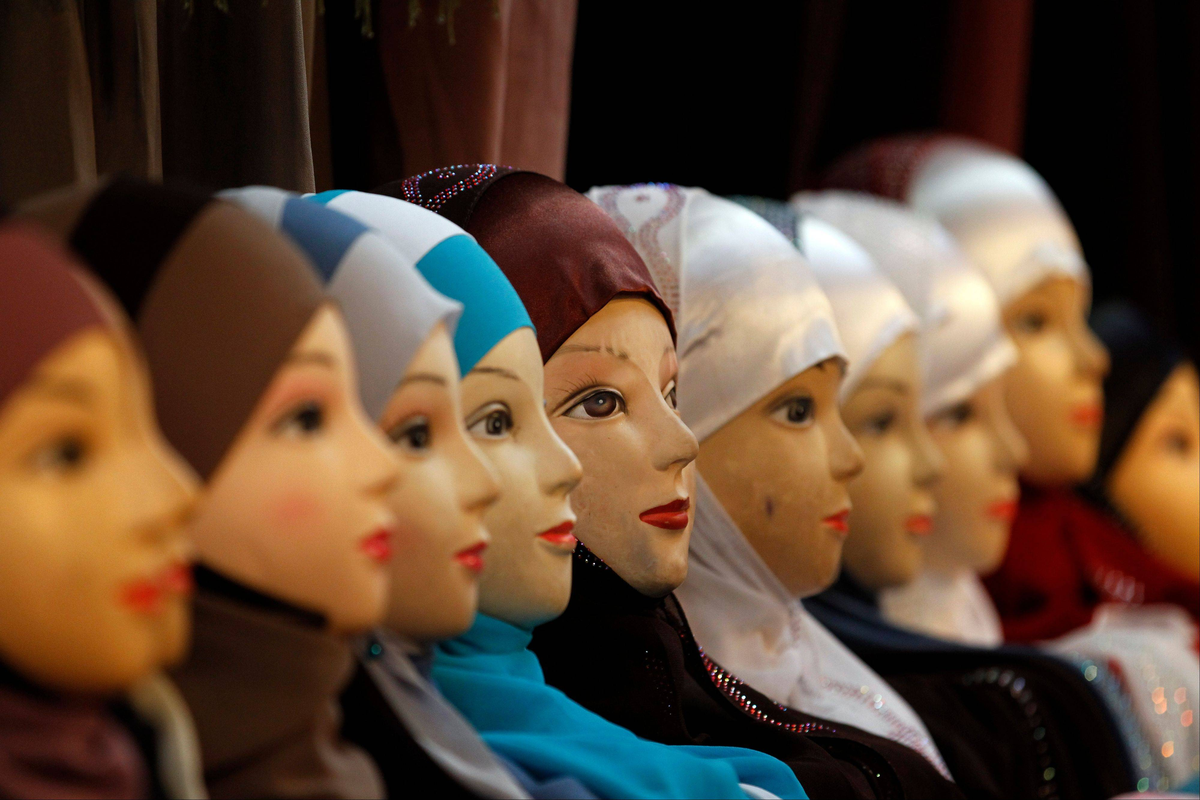 Mannequins with veils are seen on display at an exhibition hall for the Muslim World Fair in Le Bourget, outside Paris, in 2011. A British judge's decision this week permitting a female Muslim defendant to wear a full face veil in court, but requiring her to remove it when giving evidence, has reignited a debate about Muslim veils that has flared across Europe.