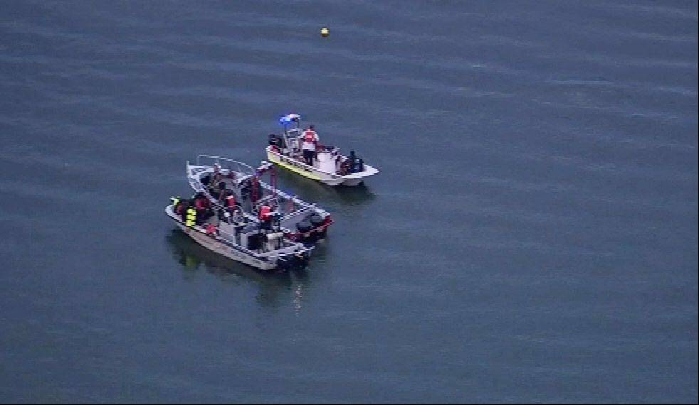 Divers looking for a missing person on Lake Marie near Antioch Tuesday night.