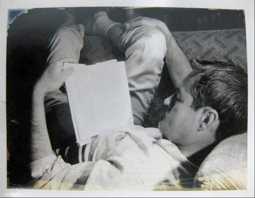 In this circa 1961 file photo provided by the New York Public Library, a curled-up Timothy Leary reads a book. Leary saved thousands of documents, correspondence and writings relating to his scientific research into psychedelic drugs in the 1960s, much of it never published but now available to scholars and the public at the New York Public Library, which purchased the collection in 2011 from the Leary estate.
