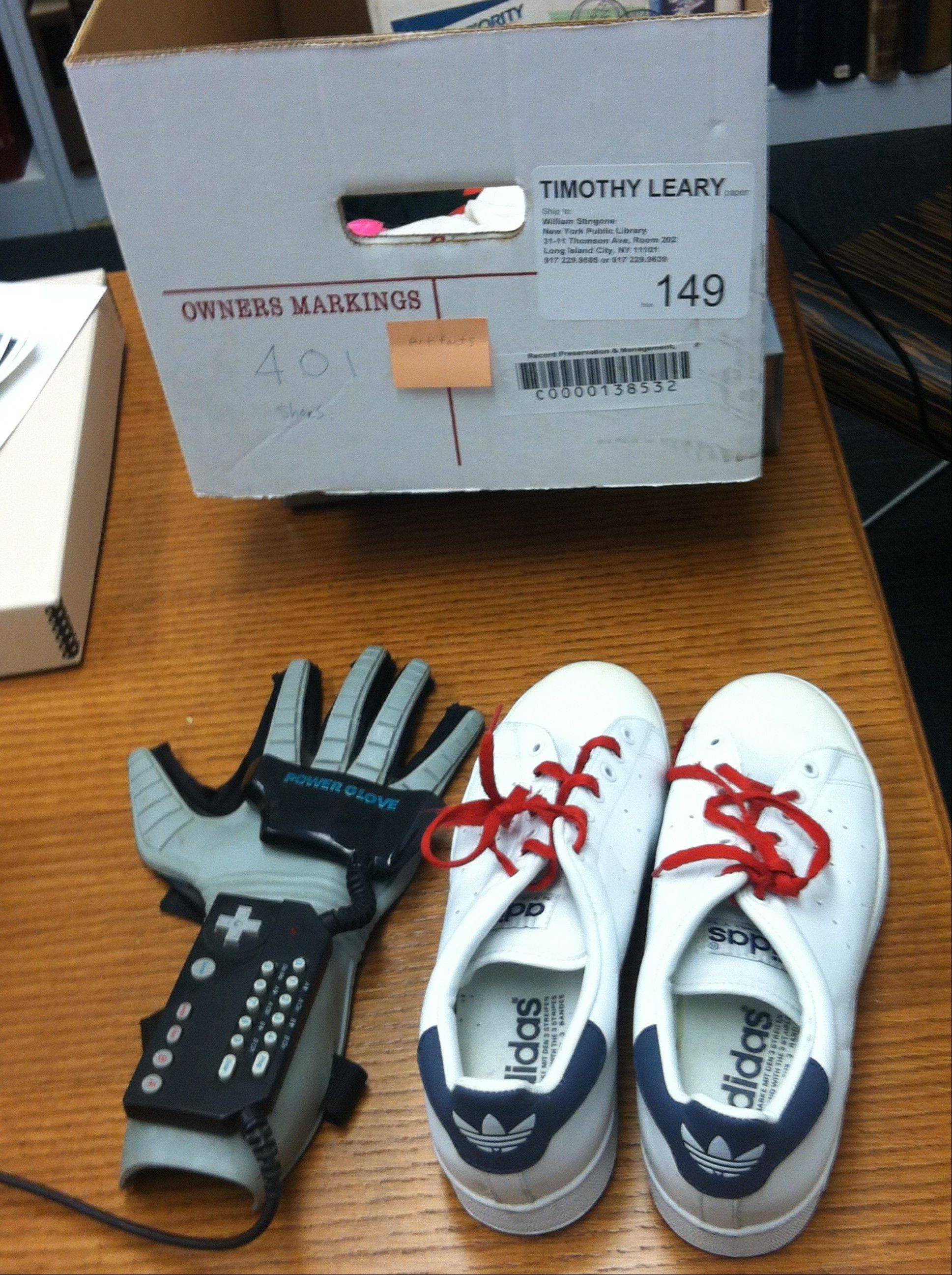 Timothy Leary's Nintendo power glove and sneakers. The items are among thousands of documents, correspondence, writings and personal belongings relating to Leary's scientific research into psychedelic drugs in the 1960s, now available to scholars and the public at the New York Public Library, which purchased the collection in 2011 from the Leary estate.