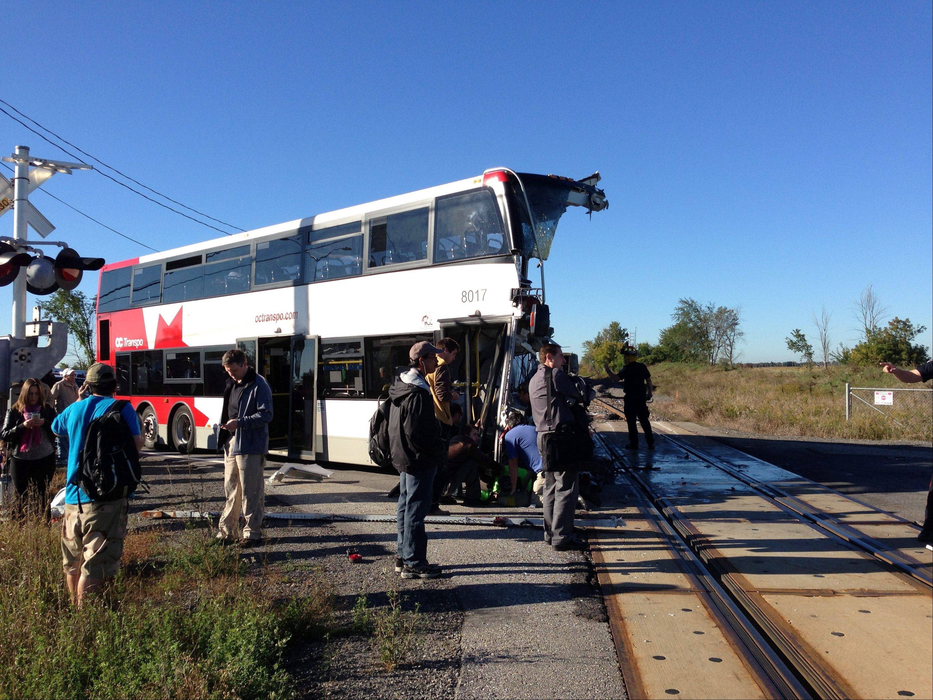 A city bus is severely damaged after colliding with a Via Rail passenger train at a crossing in Ottawa, Ontario, Wednesday, Sept. 18, 2013. An Ottawa Fire spokesman told CP24 television there are ìmultiple fatalitiesî and a number are injured from the bus but no injuries on the train.