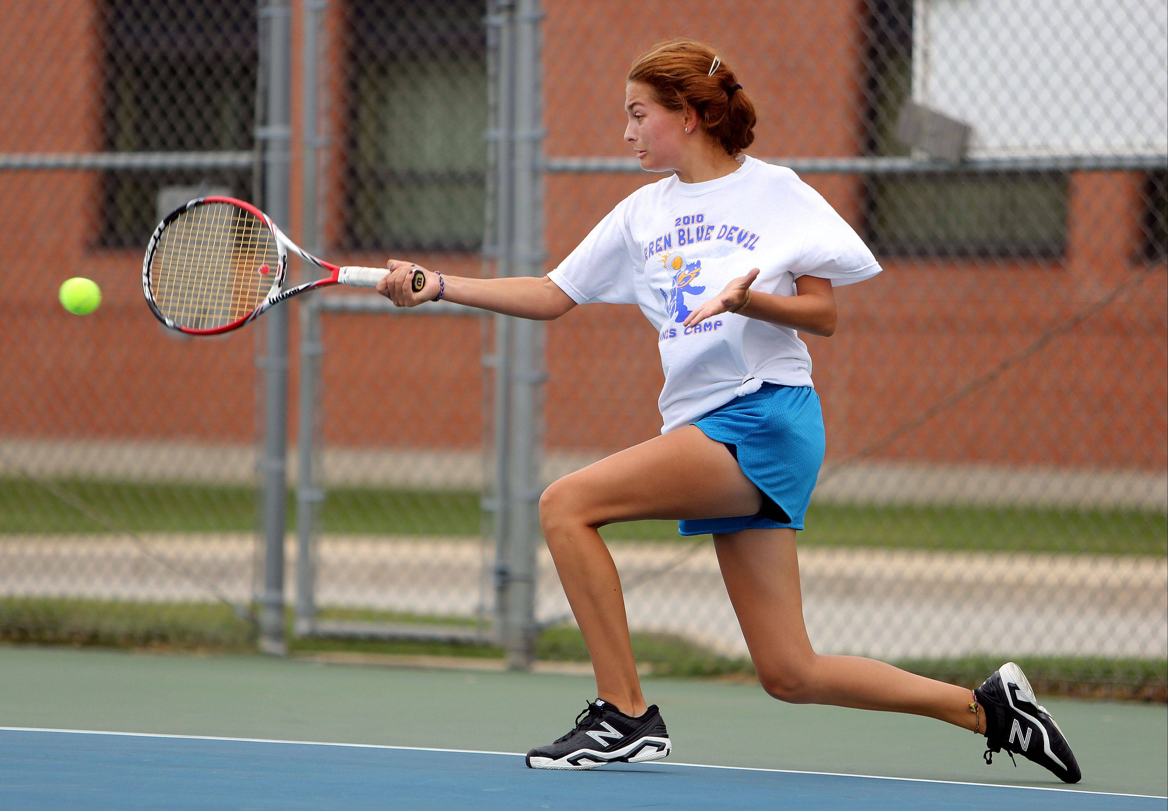 Warren's Karyna Bihel hits a forehand during action Wednesday at Warren.