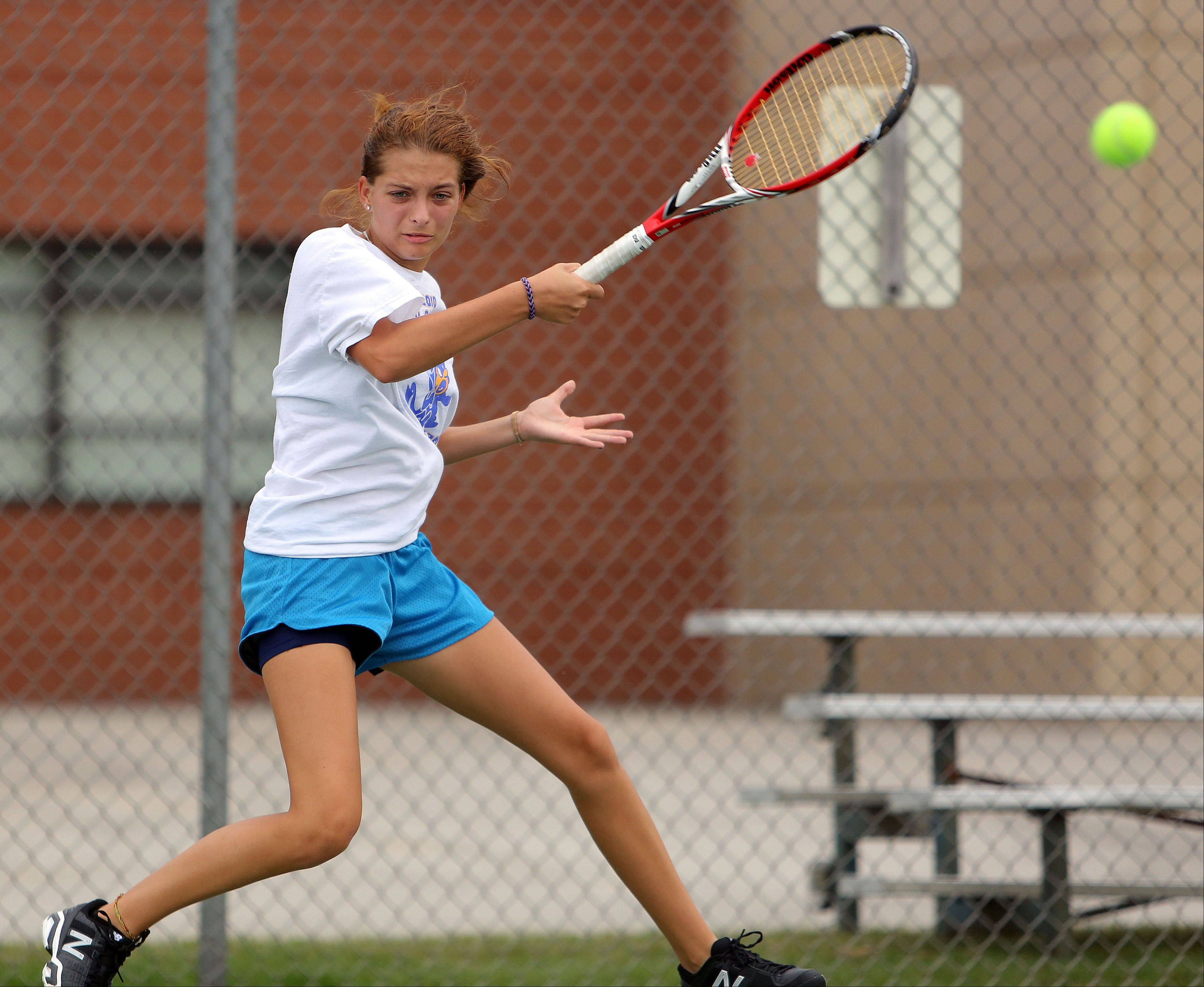Warren's Karyna Bihel delivers a forehand against Stevenson on Wednesday.