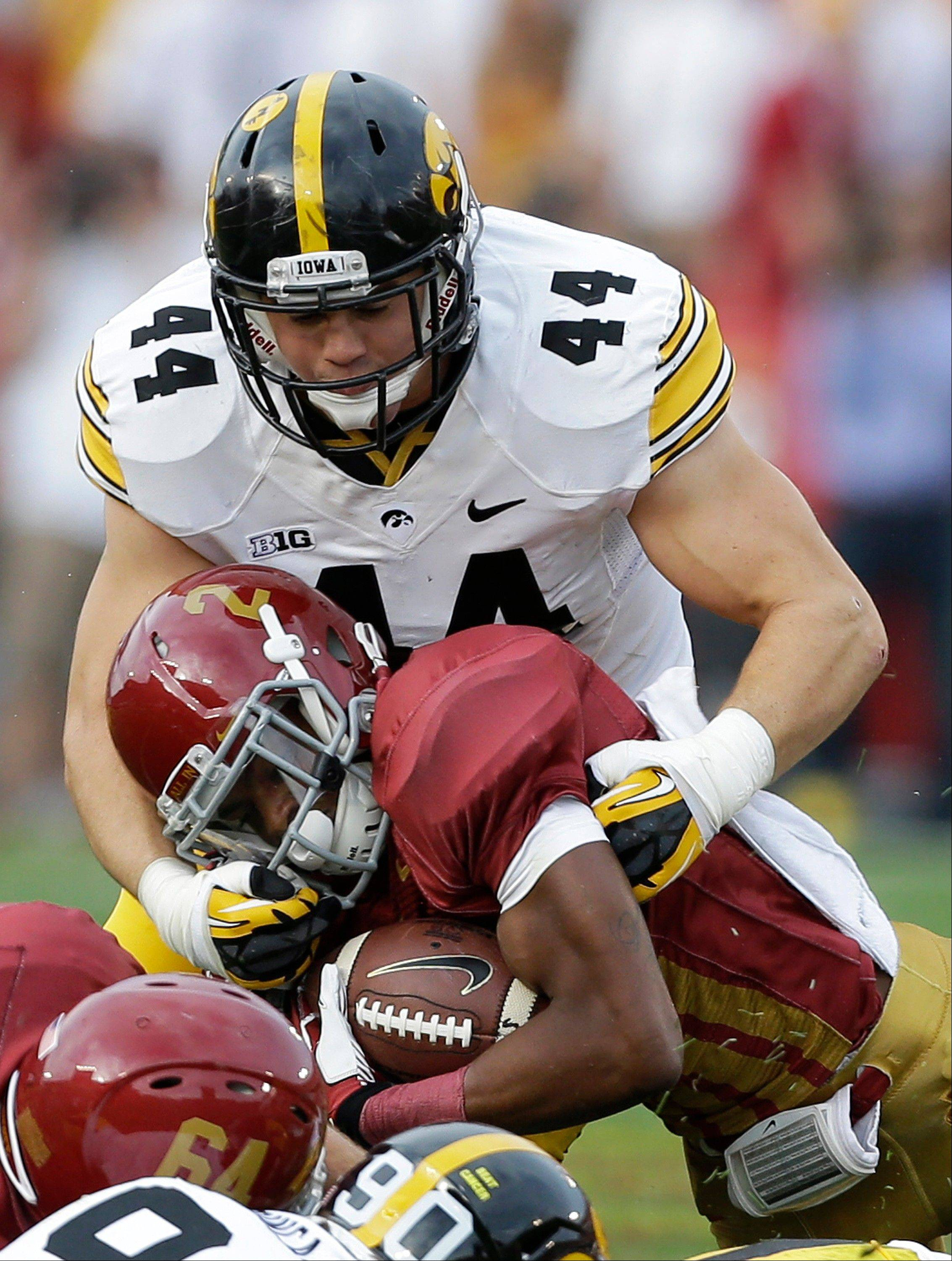 Iowa linebacker James Morris tackles Iowa State running back Aaron Wimberly during the first half of Iowa's win Saturday in Ames.