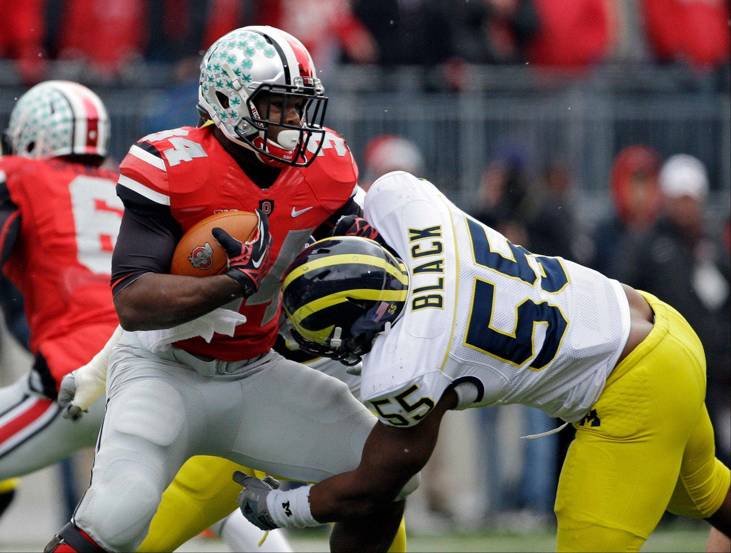 After a three-game suspension, Carlos Hyde returns to No. 4 Ohio State's backfield, creating a glut of players all seeking carries for the Buckeyes when they play Florida A&M on Saturday.