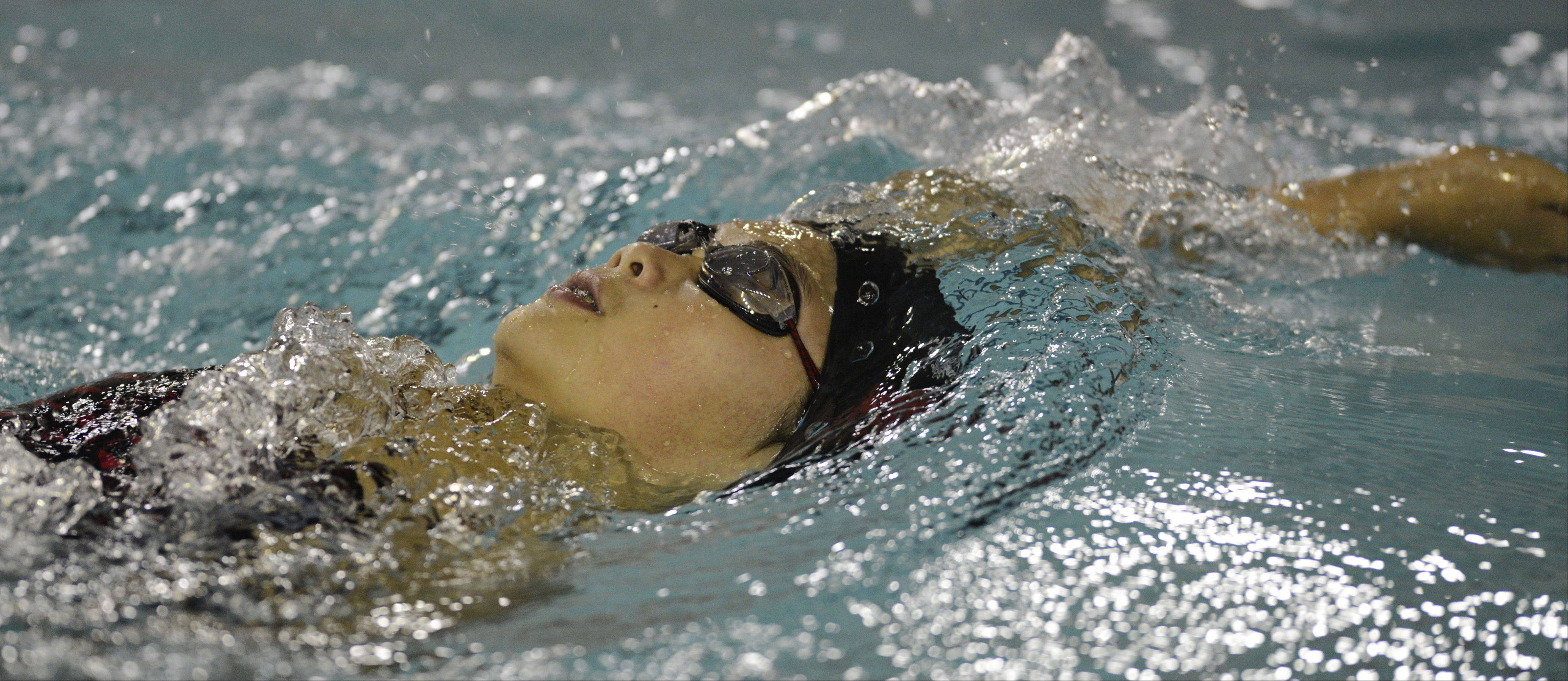 Palatine's Lily Zahn swims the backstroke portion of the 200-meter IM during Wednesday's meet with Hoffman Estates.