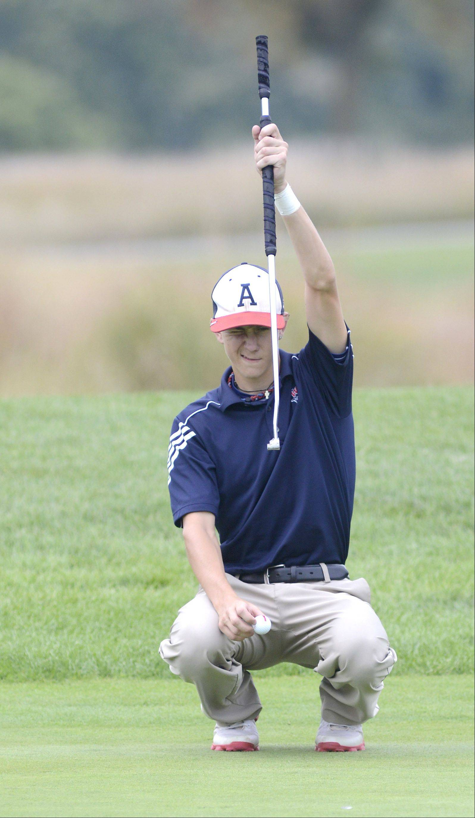 West Aurora's Mike Golich lines up his shot on the third green at Phillips Park Golf Course in Aurora on Wednesday, September 18.