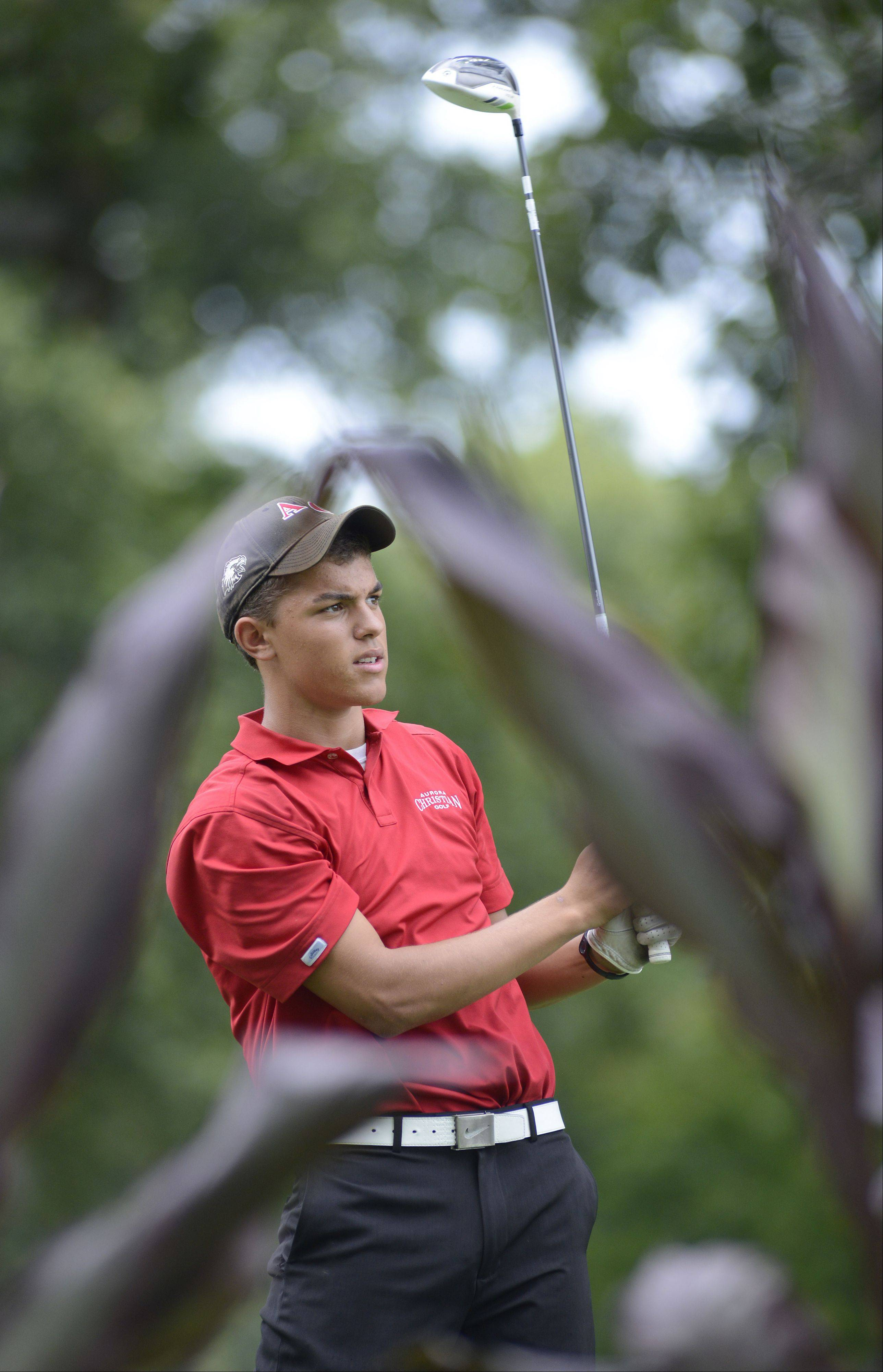 Aurora Christian's Jackson Hayes tees off at the fifth hole at Phillips Park Golf Course in Aurora on Wednesday, September 18.