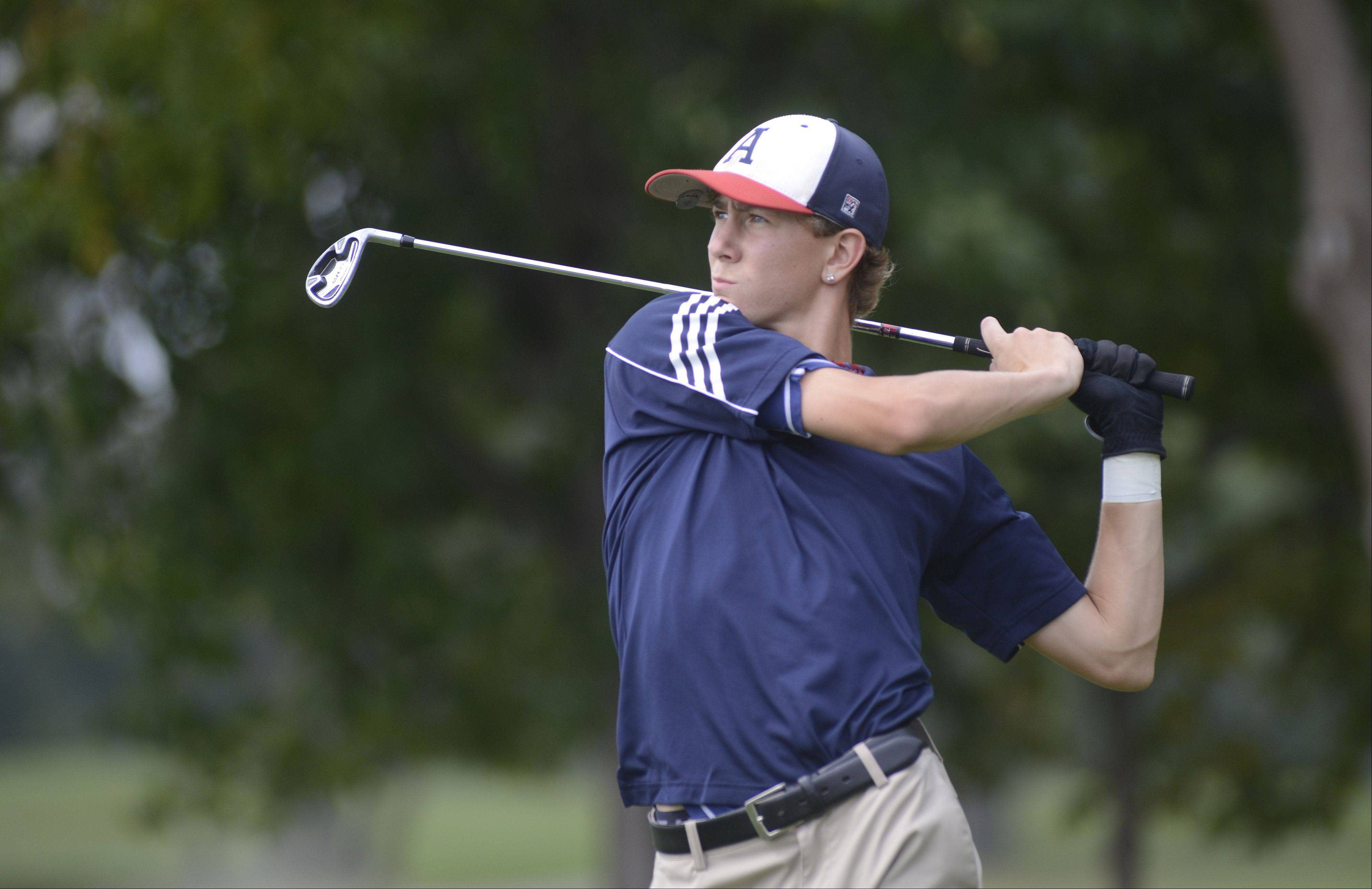 West Aurora's Mike Golich tees off at the second hole at Phillips Park Golf Course in Aurora on Wednesday, September 18.