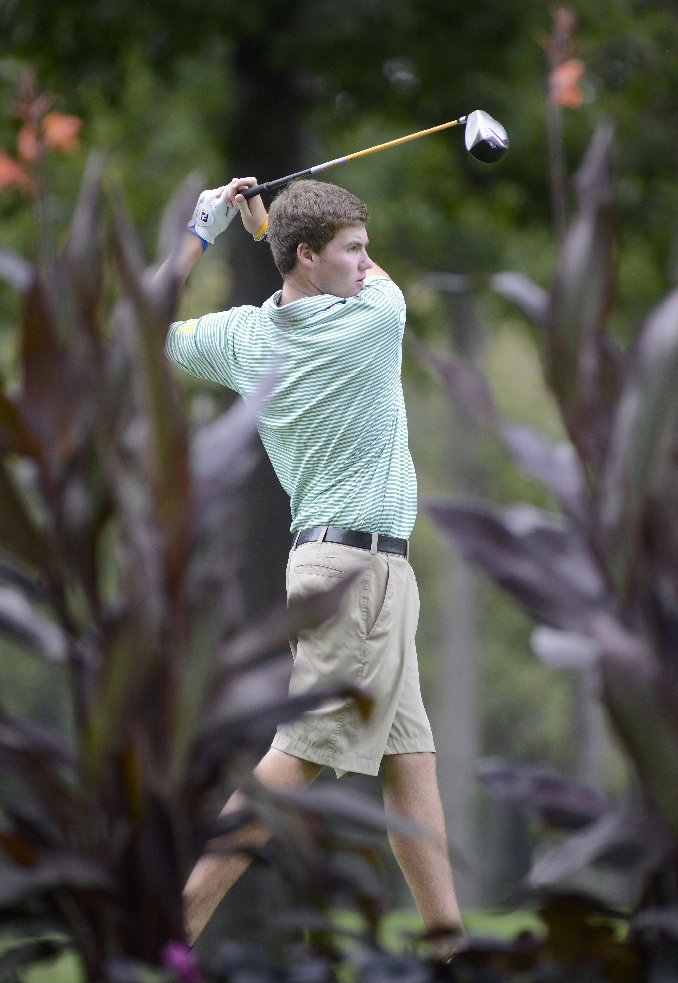 Waubonsie Valley's Jason Marrs tees off at the fifth hole at Phillips Park Golf Course in Aurora on Wednesday, September 18.