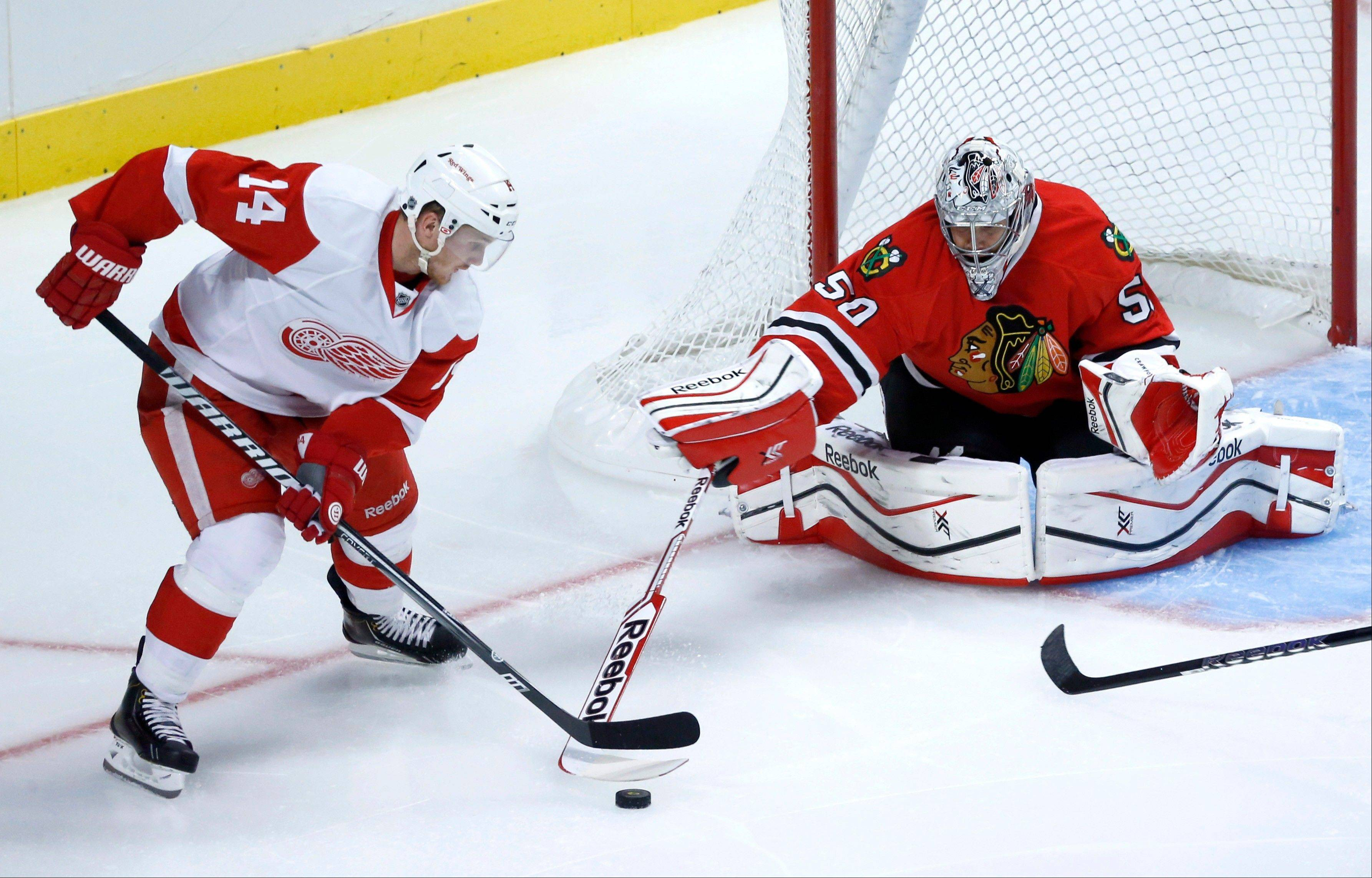 Blackhawks goalie Corey Crawford says he doesn't mind the shorter pads mandated by NFL officials in the offseason. Crawford shutout the Red Wings in the Hawks' preseason opener Tuesday.