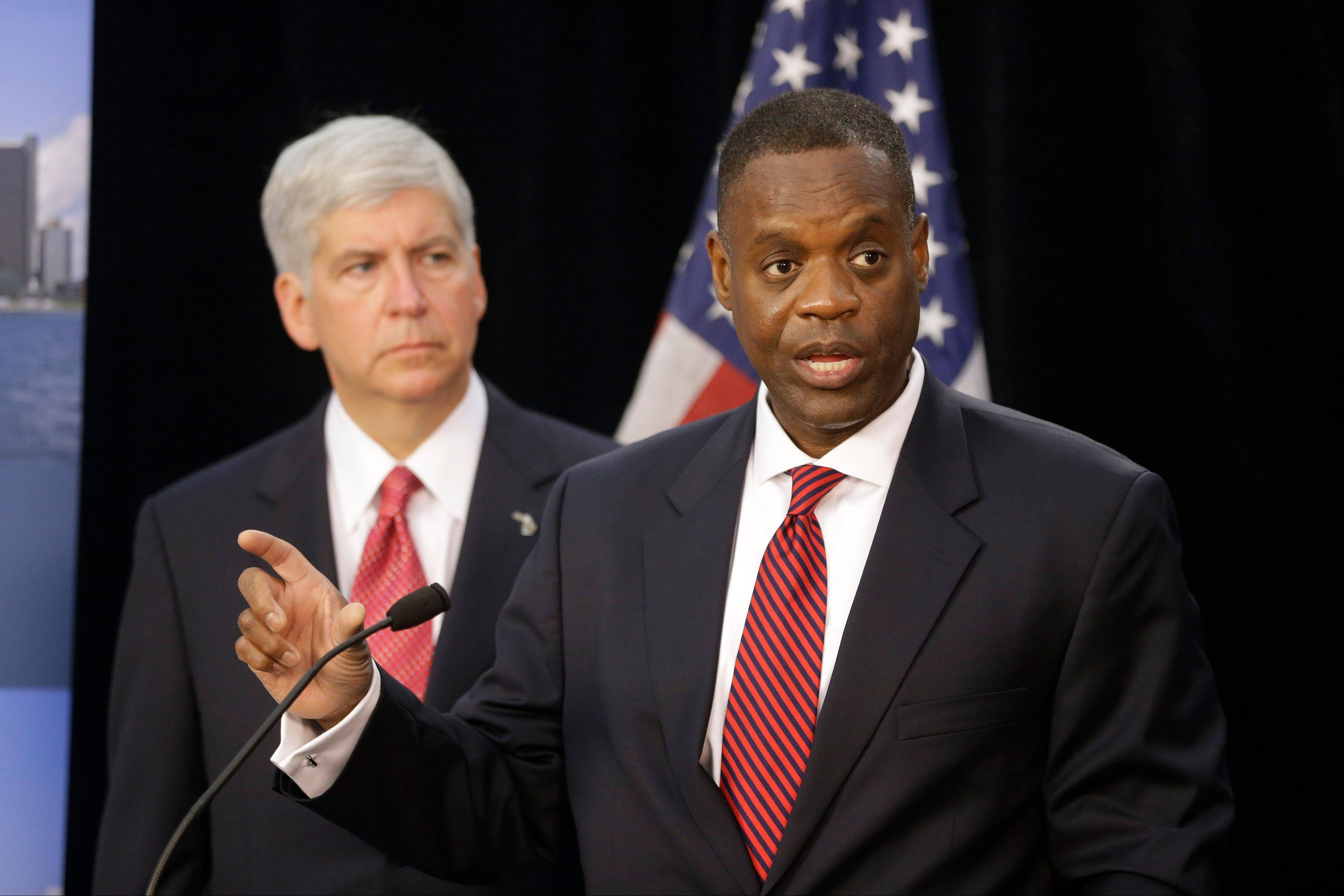 "FILE - In a July 19, 2013, file photo state-appointed emergency manager Kevyn Orr, right, and Michigan Gov. Rick Snyder, address the media during a news conference in Detroit. A judge told a courtroom packed with lawyers Tuesday, Sept. 17, 2013, that deals between Detroit and its creditors would be better than years of ""horrendous"" litigation in the largest public bankruptcy in U.S. history. Eastern Michigan's chief federal judge, Gerald Rosen, opened the first formal round of mediation by giving a pep talk and introducing other experts who will work with the city and its creditors to try to reach settlements while the bankruptcy case moves separately through court. (AP Photo/Carlos Osorio)"