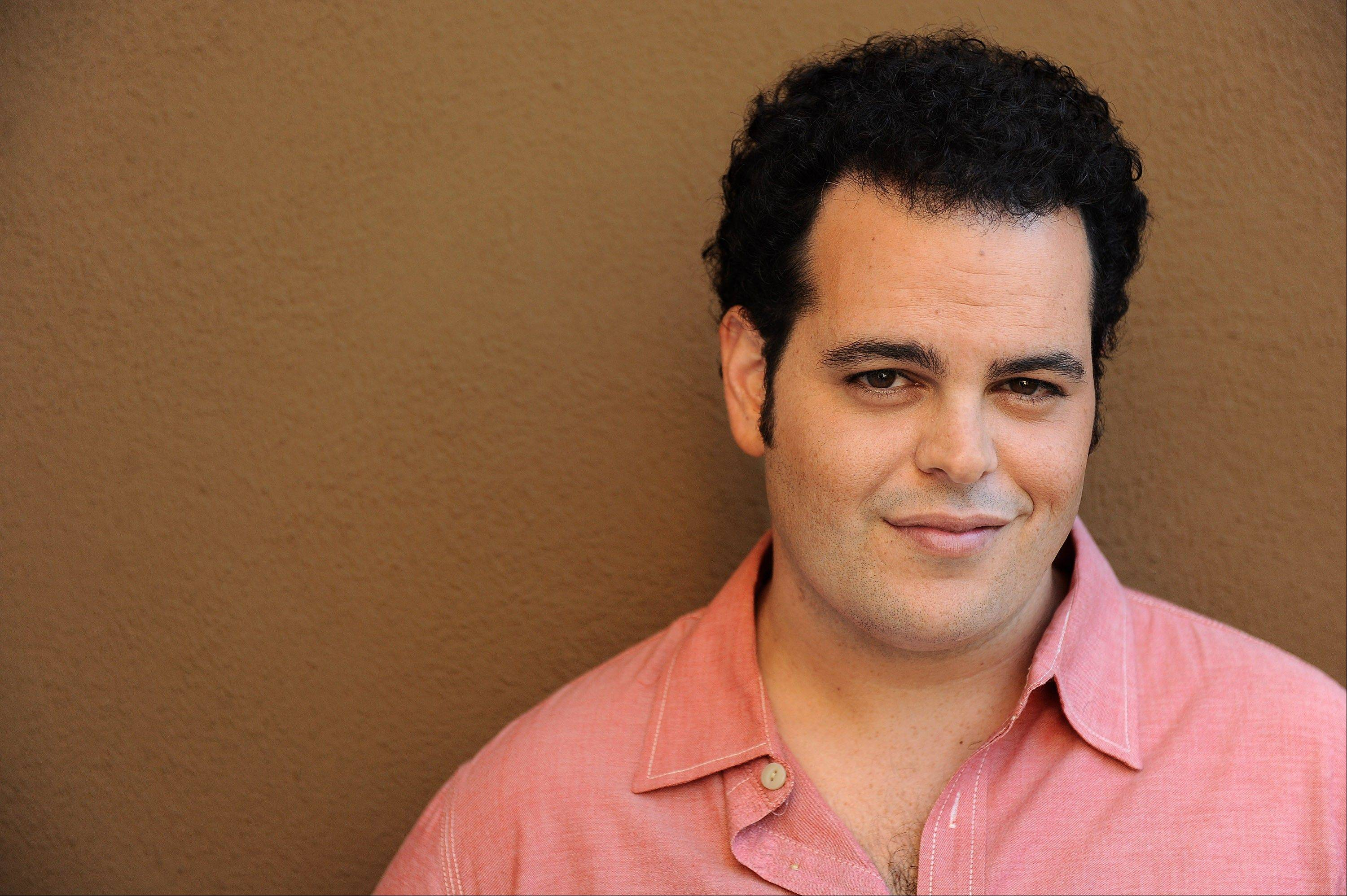 FILE - In this Monday, Sept. 16, 2013 file photo, Josh Gad poses for a portrait at the Four Seasons Hotel, in Los Angeles. Gad has a spate of acting and writing projects in the works, including an upcoming TV show with Billy Crystal and starring role in a Sam Kinison biopic, plus �Thanks for Sharing,� in theaters Friday, Sept. 20, 2013. (Photo by Jordan Strauss/Invision/AP, File)