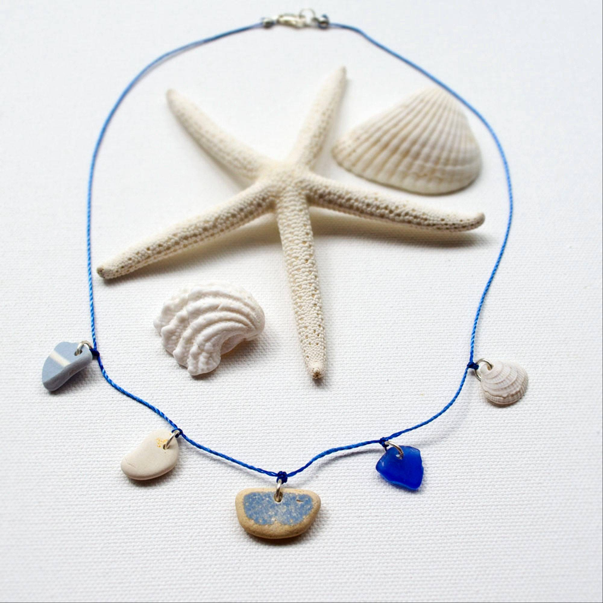 Karen Vesk of Erie, Penn., hunts for beach glass and pottery shards at the Lake Erie shoreline for pieces for a necklace that incorporates blue beach glass, a small shell and several shards of beach pottery.