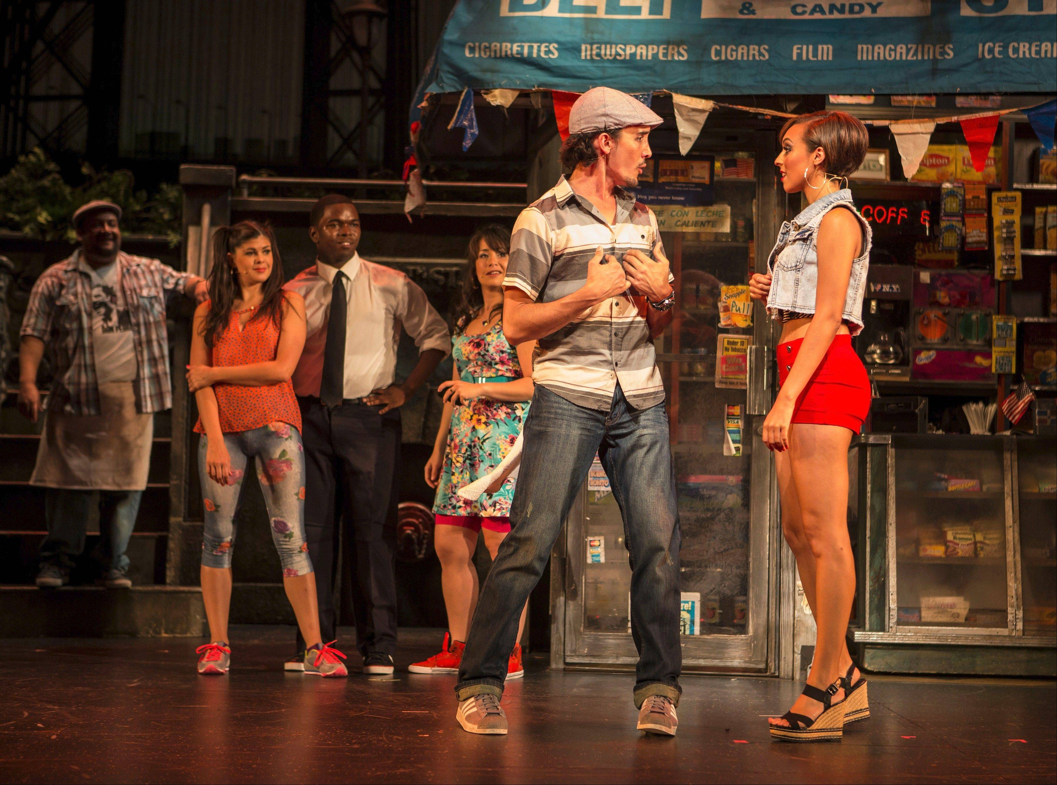 "Usnavi (Nick Demeris) nervously accepts an invitation to go dancing with Vanessa (Caitlainne Rose Gurreri) in the Tony Award-winning musical ""In the Heights"" at the Paramount Theatre in Aurora."