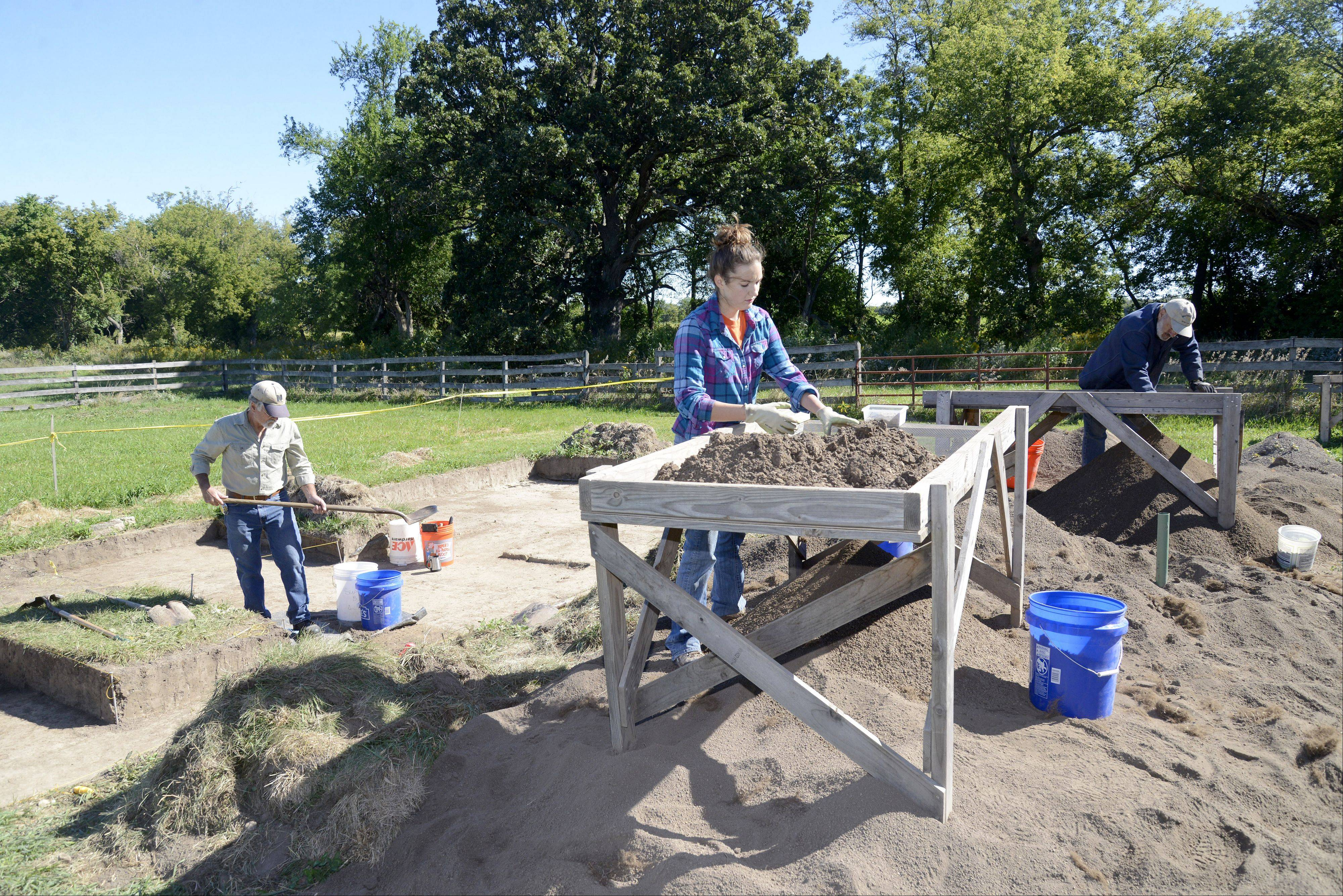 Archaeologist Jim Yingst shovels while volunteers Caitlin Harrison of Roselle and Dan Nippert of Geneva work on table screens sifting through 1 x 1 meter units of soil on a dig site of where the original log home structure once stood at Garfield Farm in Campton Hills. Sam and Margret Culbertson and their family originally claimed and settled on the land that is now known as the Garfield Farm Museum in July 1835. Culbertson sold the farm six years later to Timothy Garfield. Descendants representing four of the eight Culbertson children will be coming to town on Saturday to visit the old family homestead and view the excavation of area of where the family's original log home once stood. The site has been dug in various areas over eight seasons.