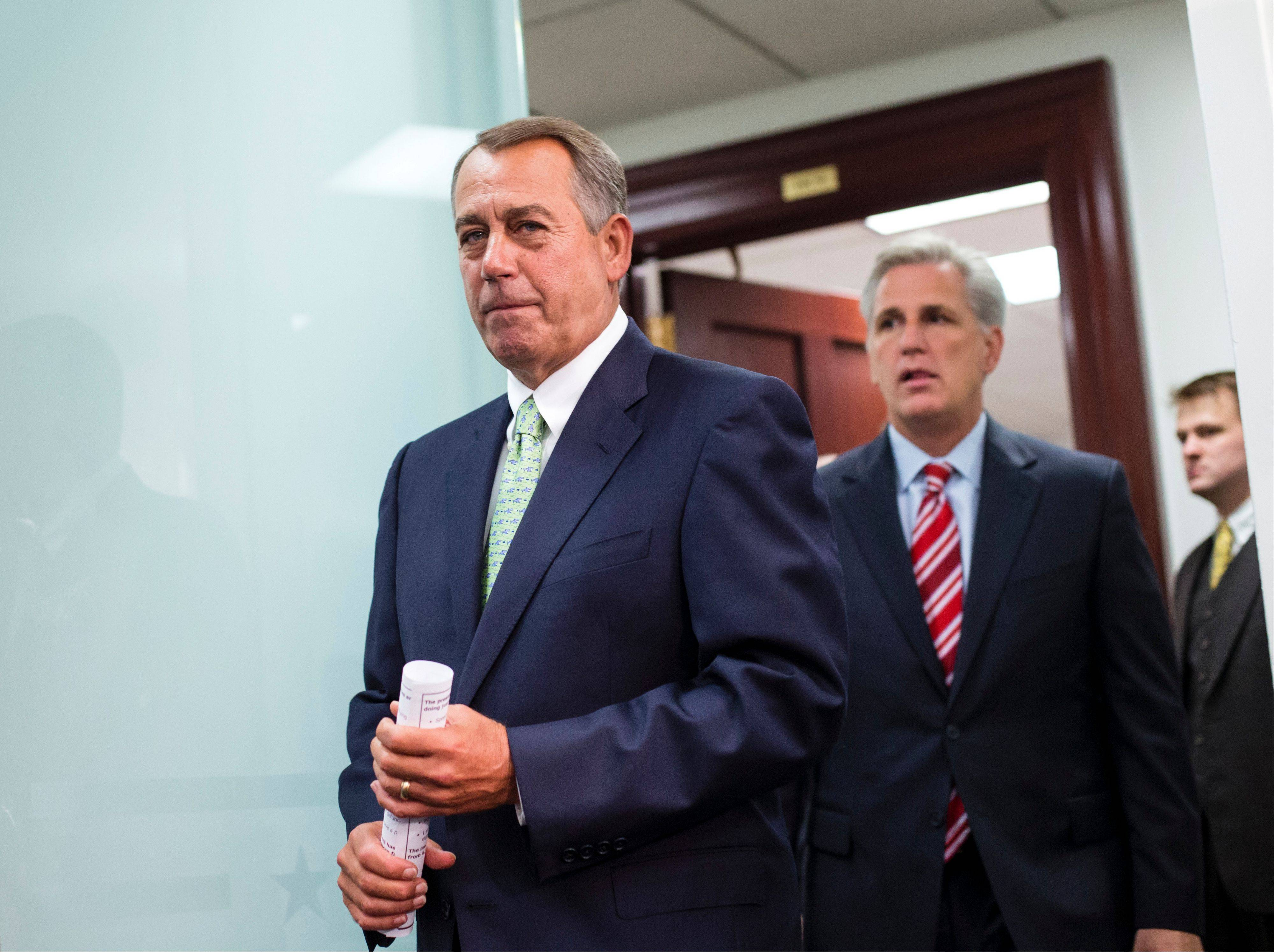 Speaker of the House John Boehner, R-Ohio, and House Republican leaders emerge from a closed-door strategy session at the Capitol, Wednesday, Sept. 18, 2013. The GOP-controlled House is cruising toward a vote to gut President Barack Obama�s health care plan as part of a temporary funding bill to prevent a partial government shutdown on Oct. 1.