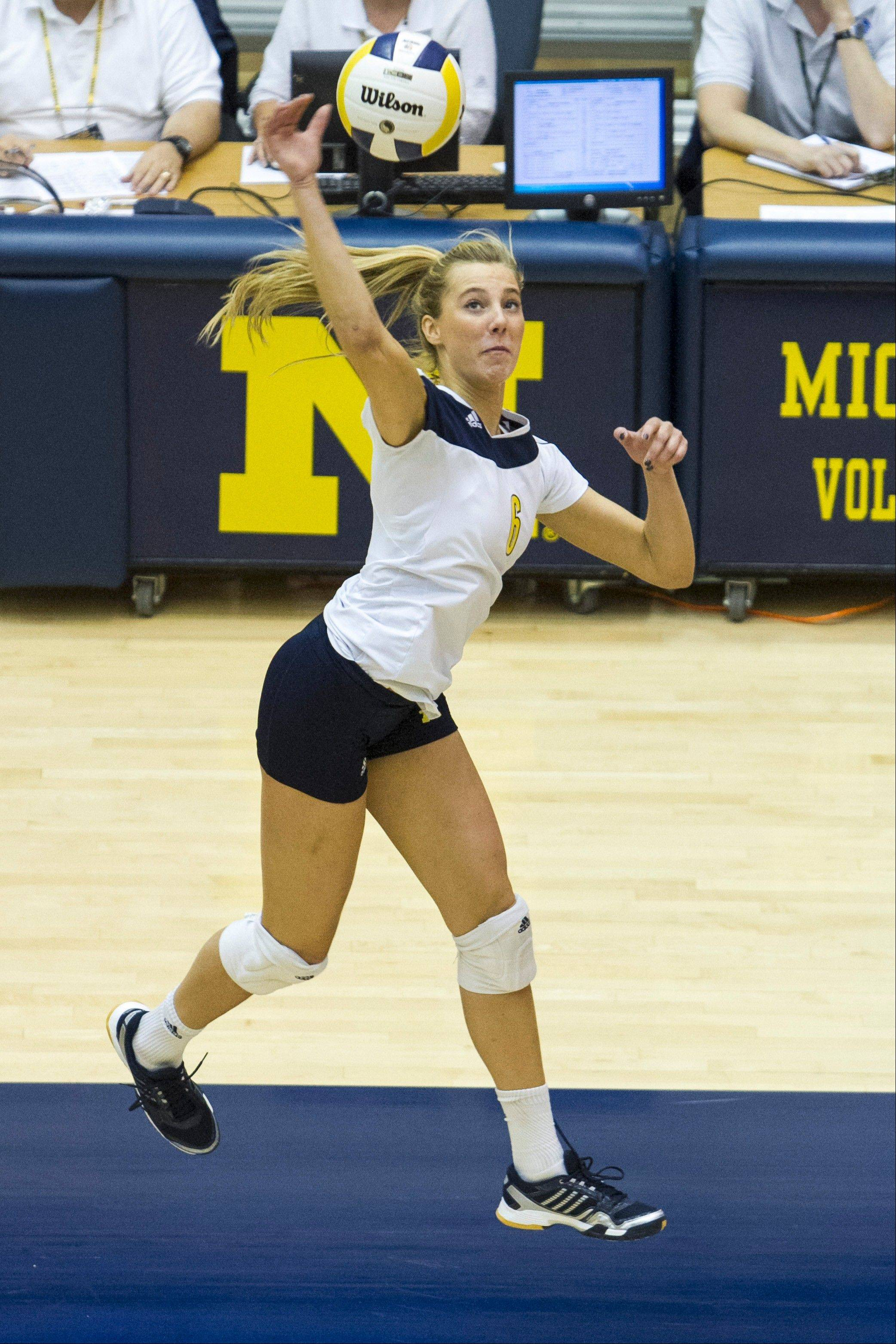University of Michigan volleyball player Ally Davis, a standout at Hinsdale Central, is back competing again after serving as a bone marrow donor last year for her older sister, Ashley.