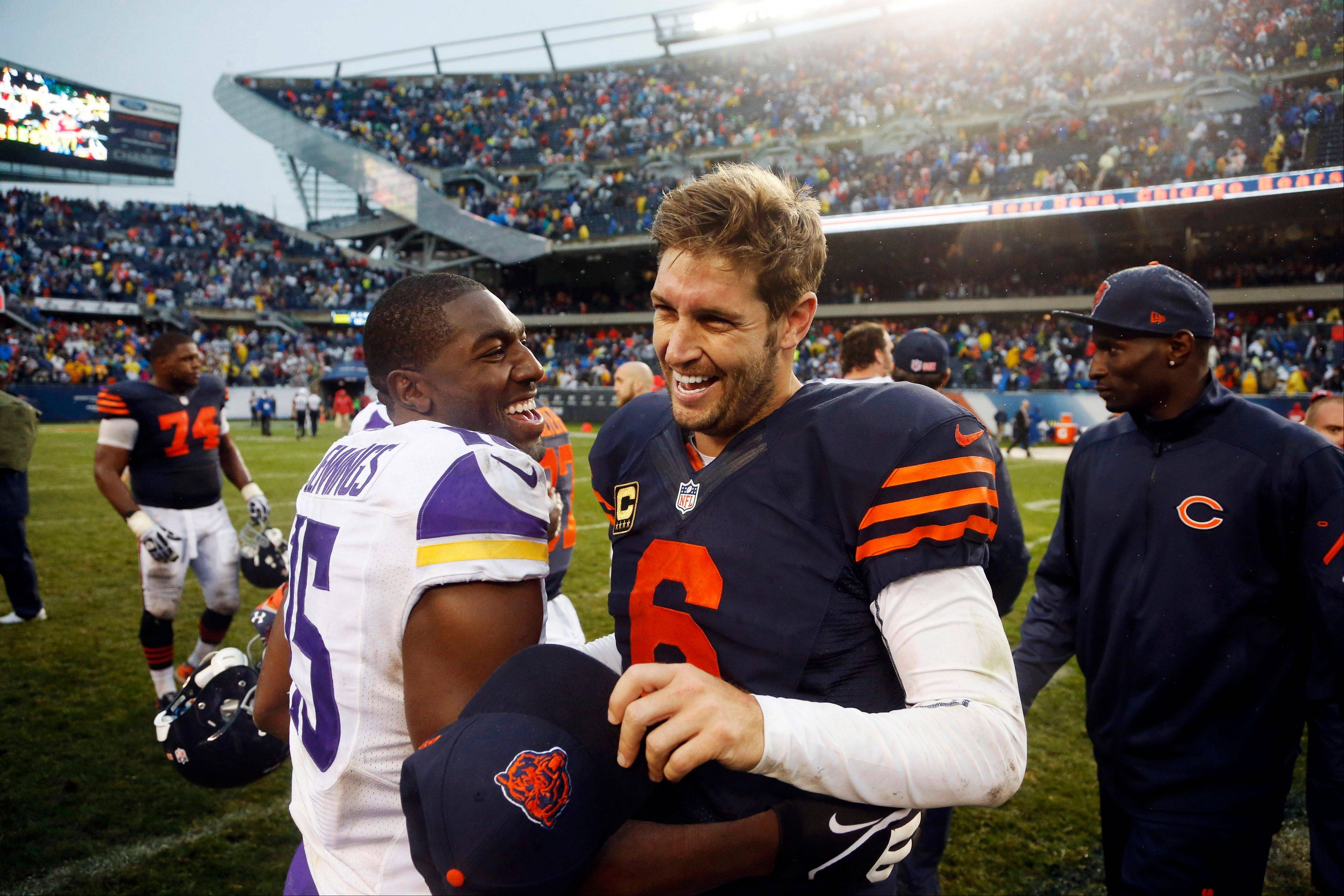 Minnesota Vikings wide receiver Greg Jennings (15) and Jay Cutler (6) laugh after the Bears beat Minnesota last Sunday.