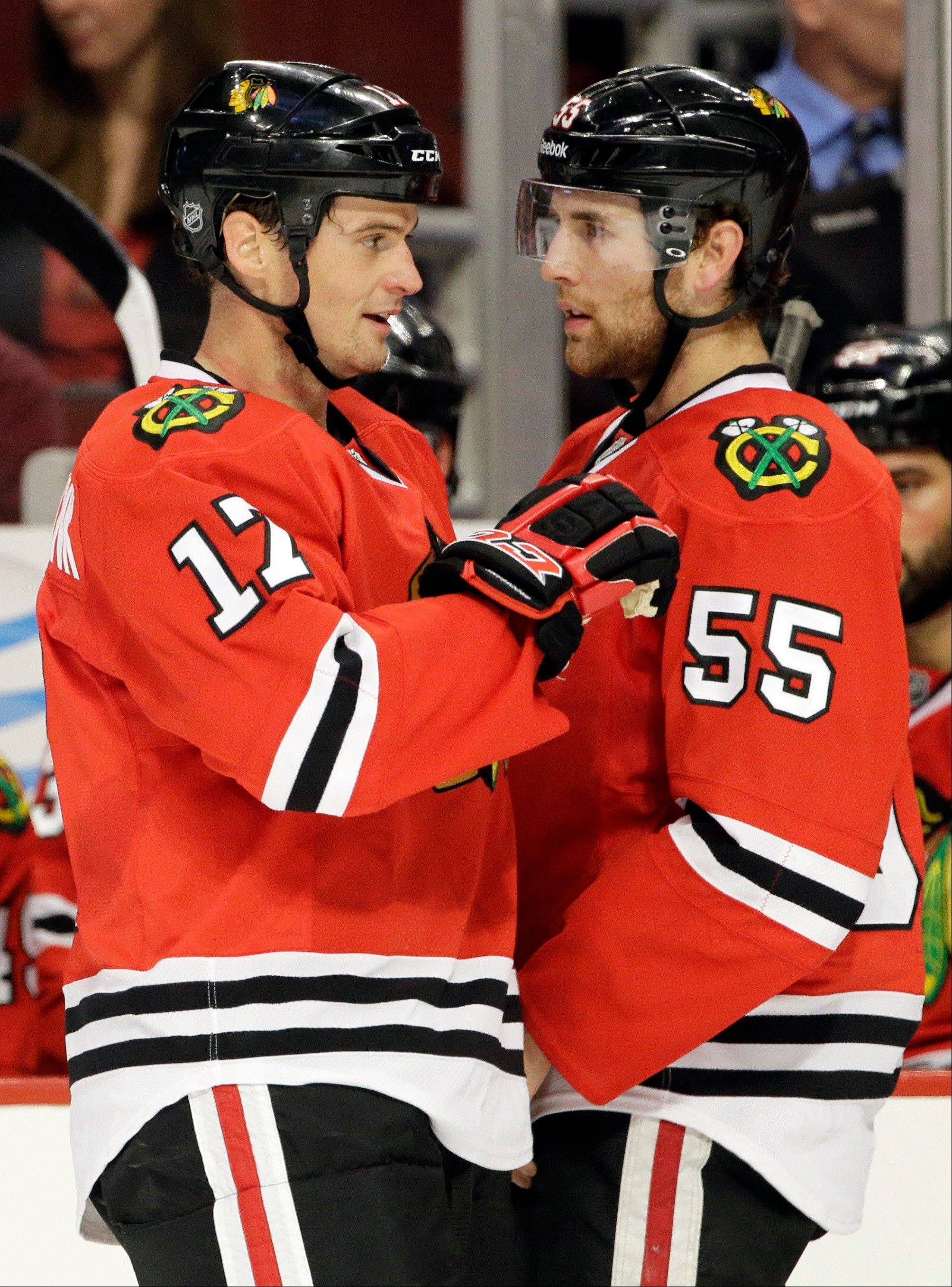 Blackhawks' Sheldon Brookbank, left, talks with Ryan Stanton during the second period of an NHL preseason hockey game against the Pittsburgh Penguins in Chicago Thursday.