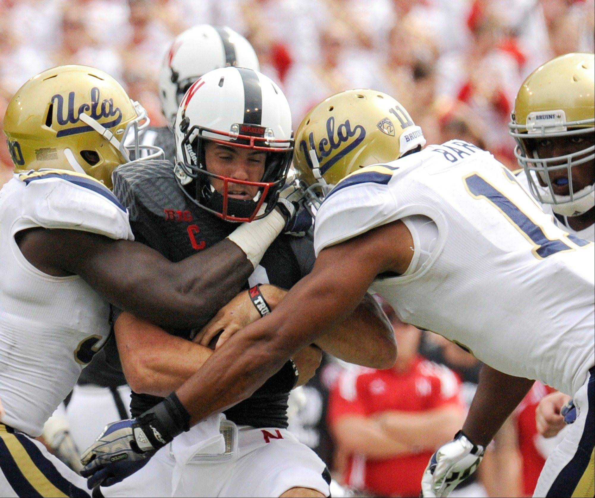 Nebraska quarterback Taylor Martinez is sandwiched by UCLA's Myles Jack, left, and Anthony Barr during the third quarter of last weekend's home loss to the Bruins. Martinez is unlikely to play this week because of turf toe.