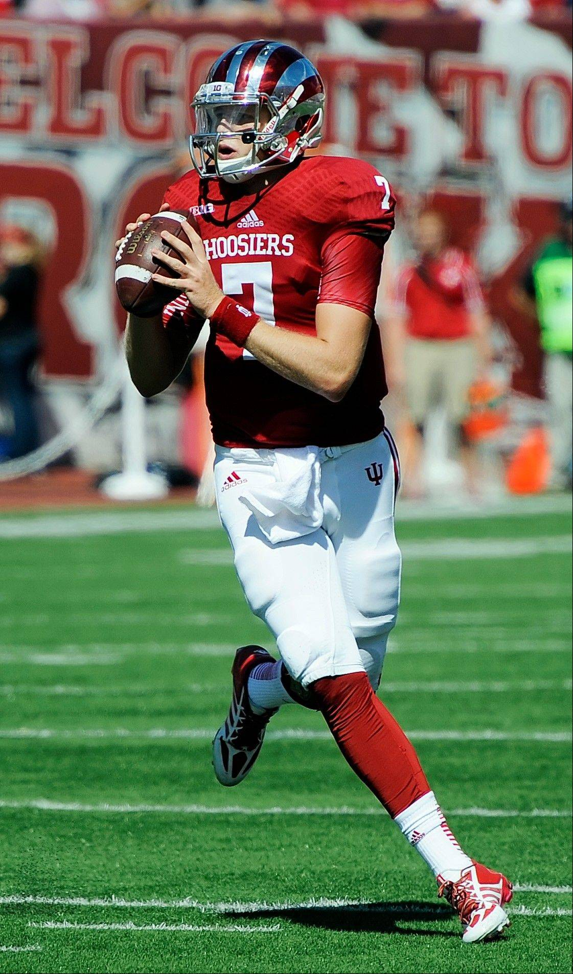 Indiana quarterback Nate Sudfeld rolls out against Bowling Green�s Shaun Joplin during last weekend�s game at Memorial Stadium in Bloomington, Ind.