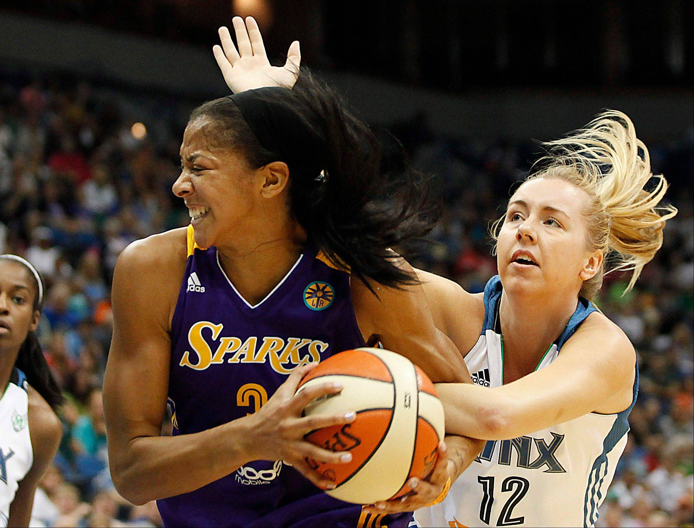 Naperville native Candace Parker, left, of the Los Angeles Sparks has won the 2013 MVP award, according to a WNBA source. Parker edged Minnesota's Maya Moore and Chicago Sky rookie Elena Delle Donne for the top honor. Parker also won the award as a rookie in 2008.