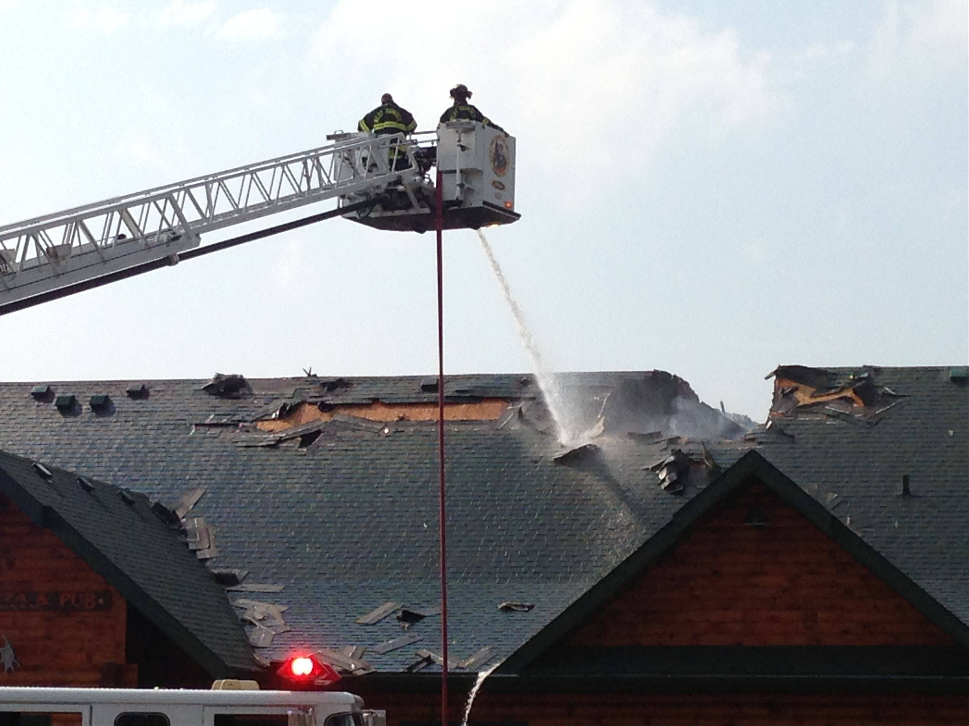 Fire crews work to control the fire Thursday at Village Pizza & Pub at 145 N. Kennedy Drive in Carpentersville. The cause is under investigation, and nobody was injured.