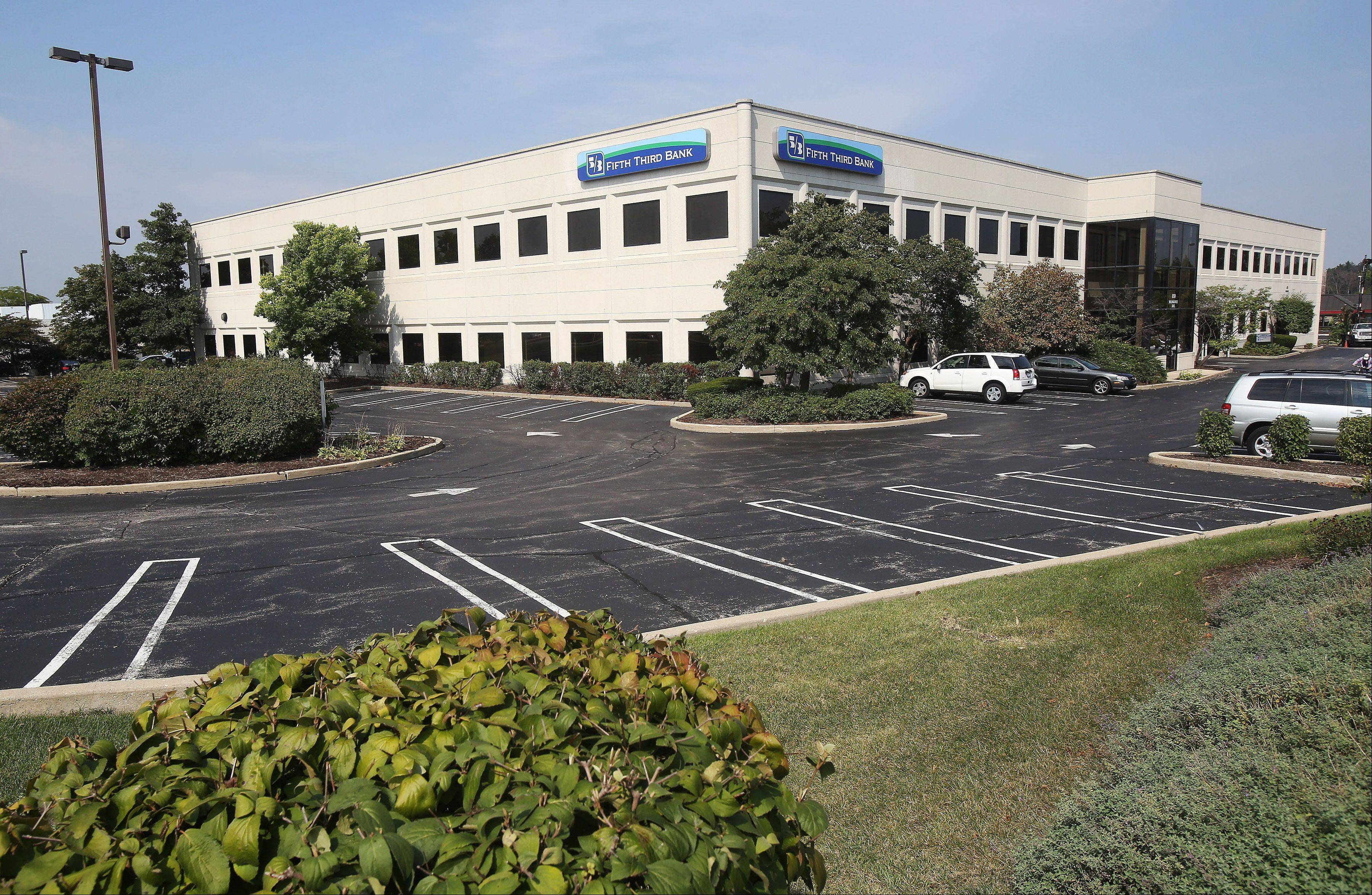A developer is seeking village approval to tear down the two-story Weiss office building near Westfield Hawthorn mall in Vernon Hills and replace it with restaurants and retail uses.