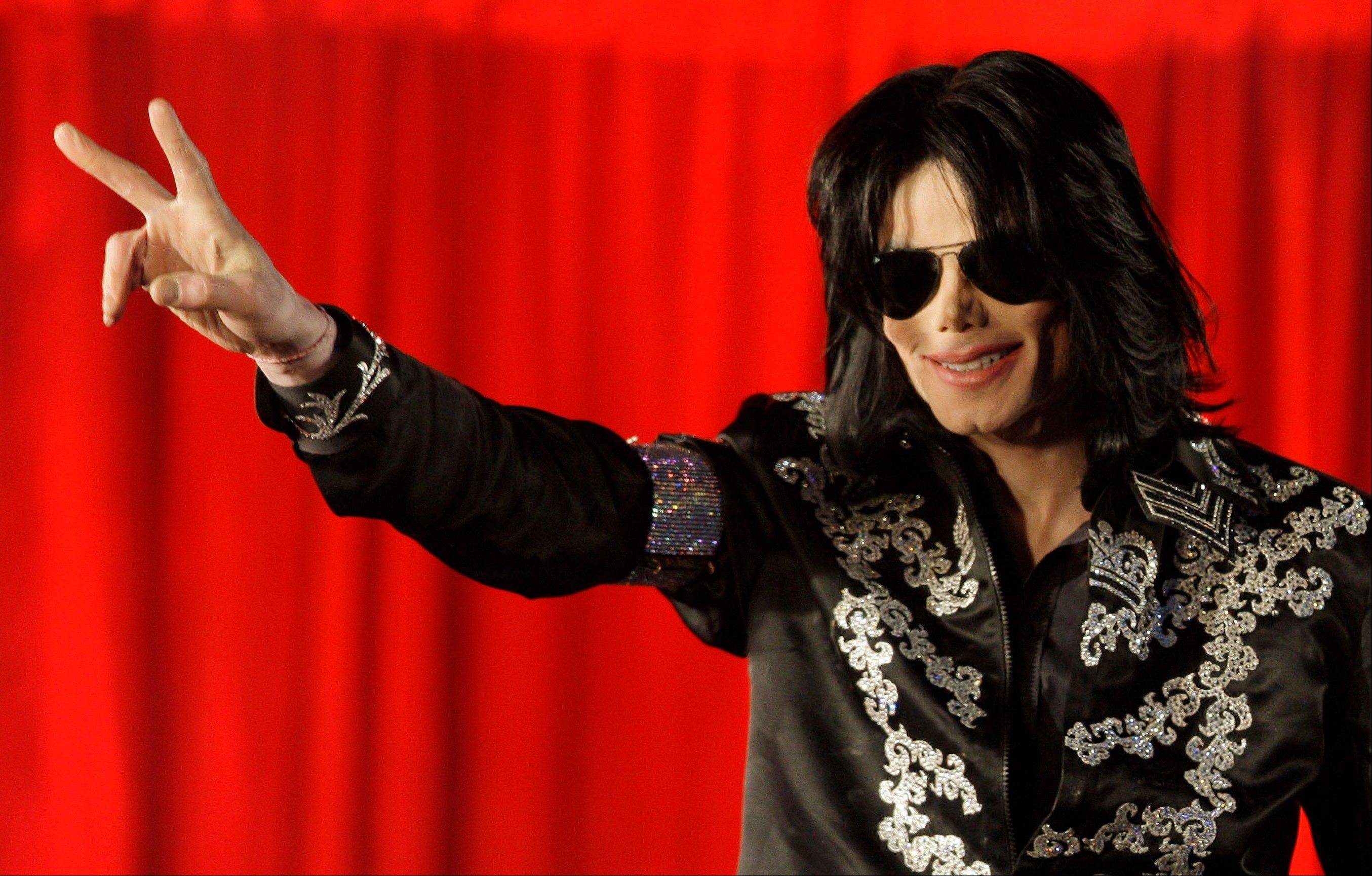 ** FILE ** In this March 5, 2009 file photo, US singer Michael Jackson announces that he is set to play ten live concerts at the London O2 Arena in July, which he announced at a press conference at the London O2 Arena. Lawyers for AEG Live LLC called their final witness on Wednesday, Sept. 18, 2013, in a negligent hiring lawsuit filed by Jackson's mother against the concert promotion company. AEG Live has shown jurors testimony from several of Jackson's former doctors and ended their case after playing the videotaped testimony of Jackson's longtime physician, Dr. Allan Metzger.