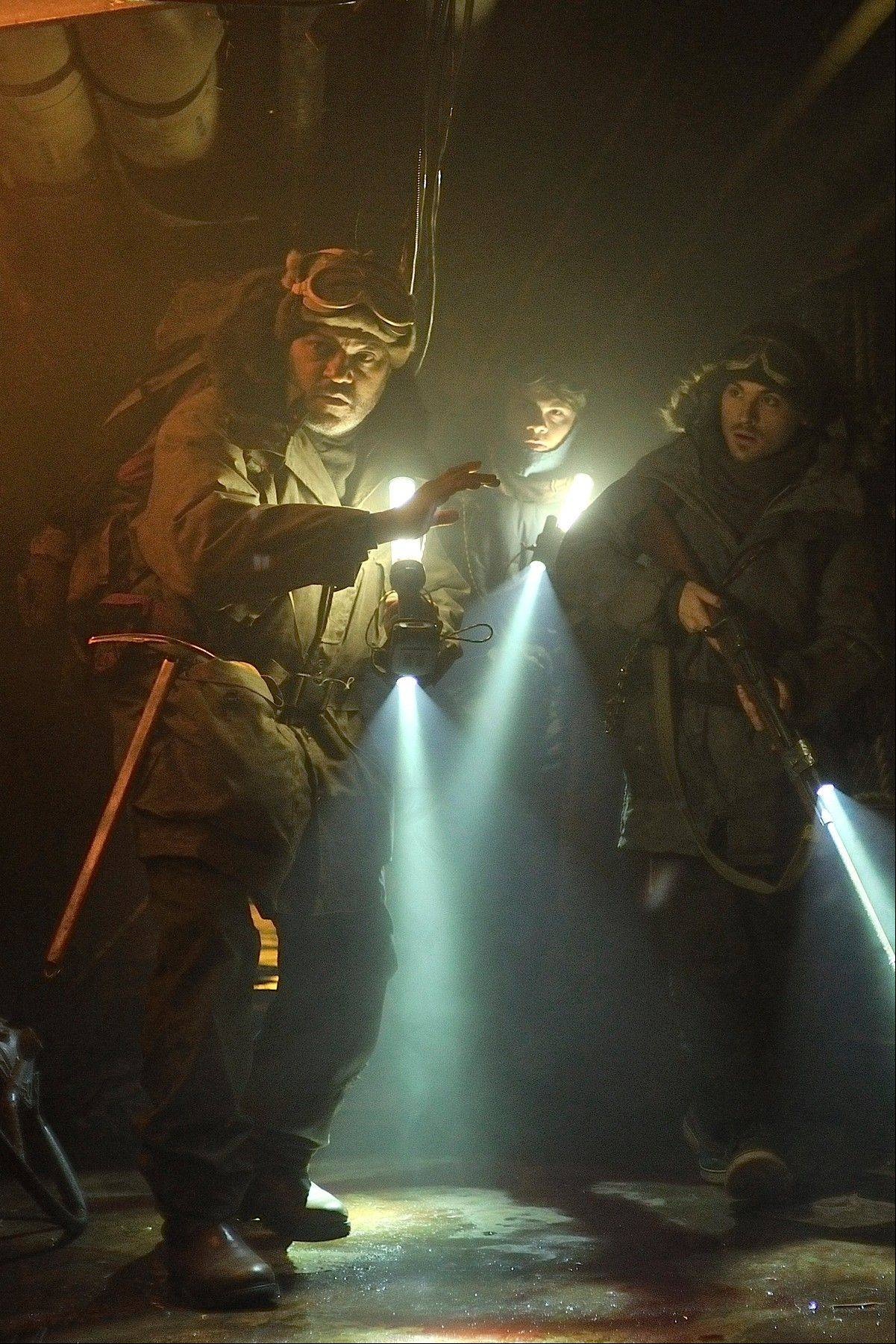 "The commander of Colony 7 (Laurence Fishburne), left, leads a rescue mission in the science-fiction horror tale ""The Colony."""