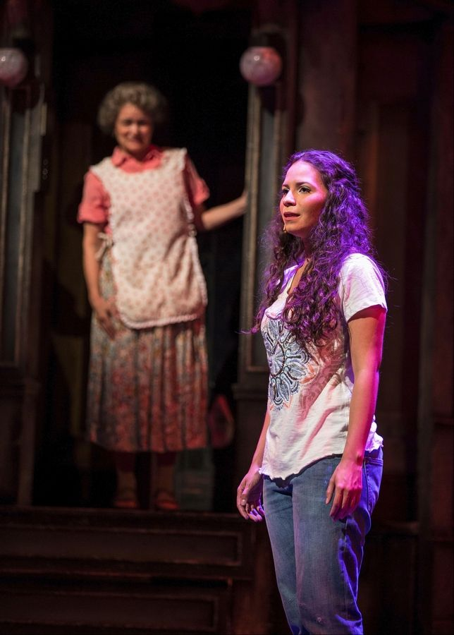 "Abuela Claudia (Paula Scrofano), left, is concerned about the returning college student Nina (Christina Nieves) in the Tony Award-winning musical ""In the Heights"" at the Paramount Theatre in Aurora."