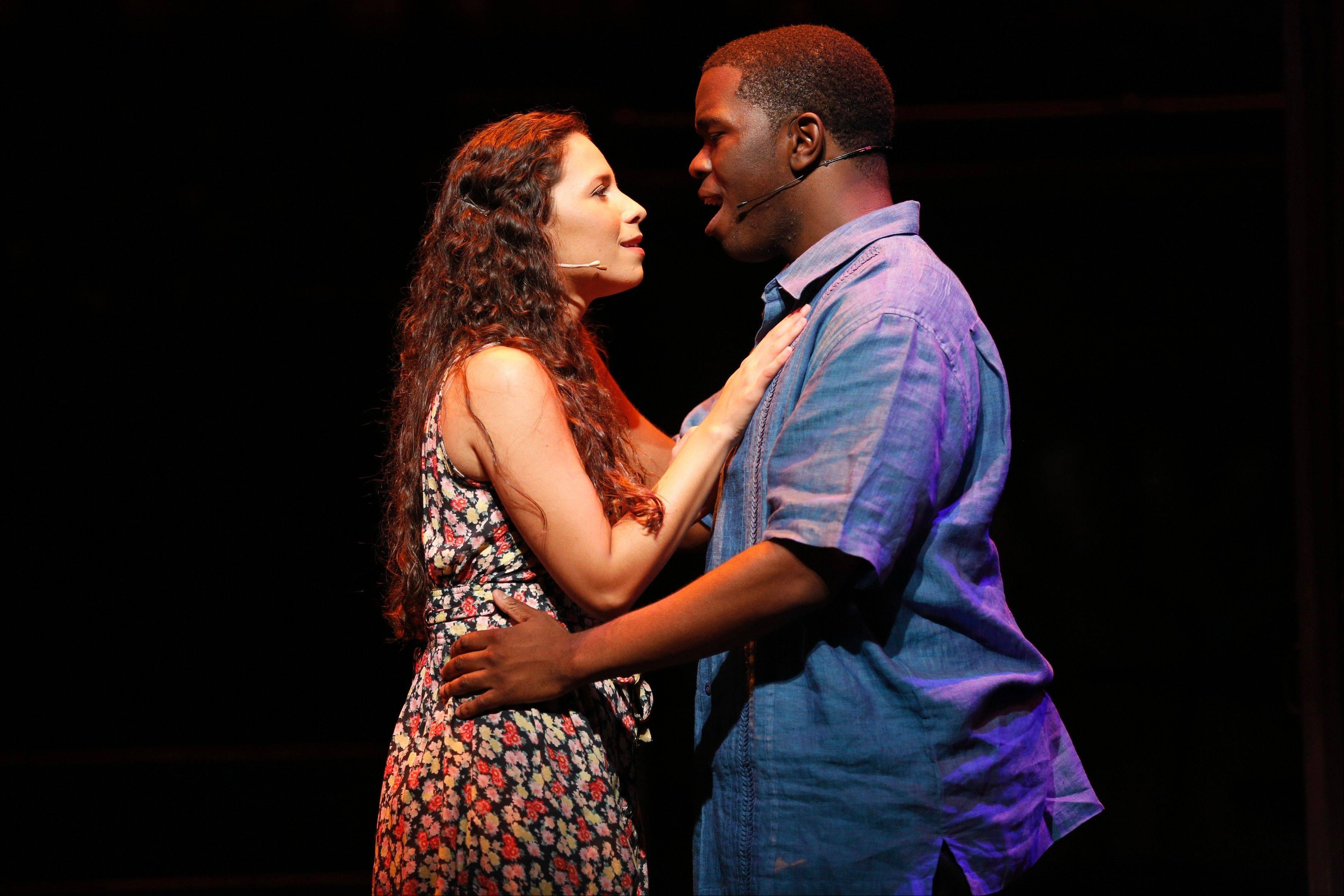 "Nina (Christina Nieves) starts to fall for Benny (Jonathan Butler-Duplessis), her father's employee, in the musical ""In the Heights"" at the Paramount Theatre in Aurora."
