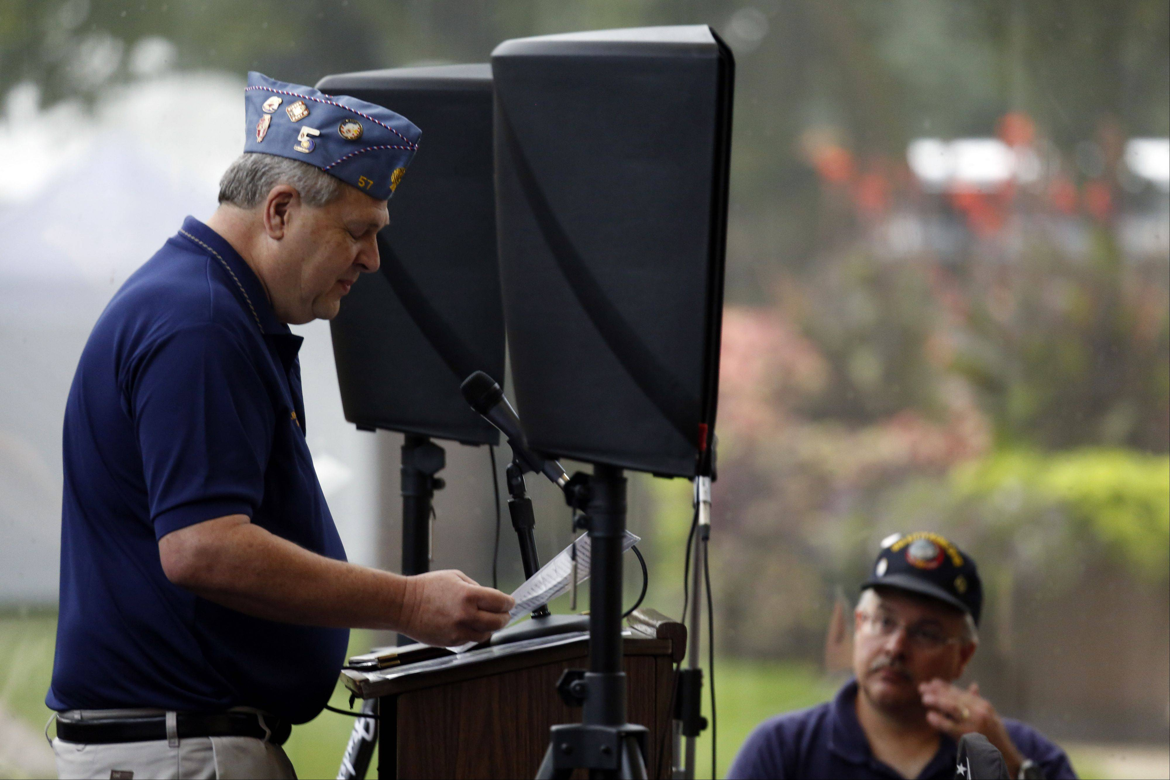 "Jerry Turnquist delivers remarks during the opening ceremony for ""The Wall That Heals"" on Thursday in Elgin."