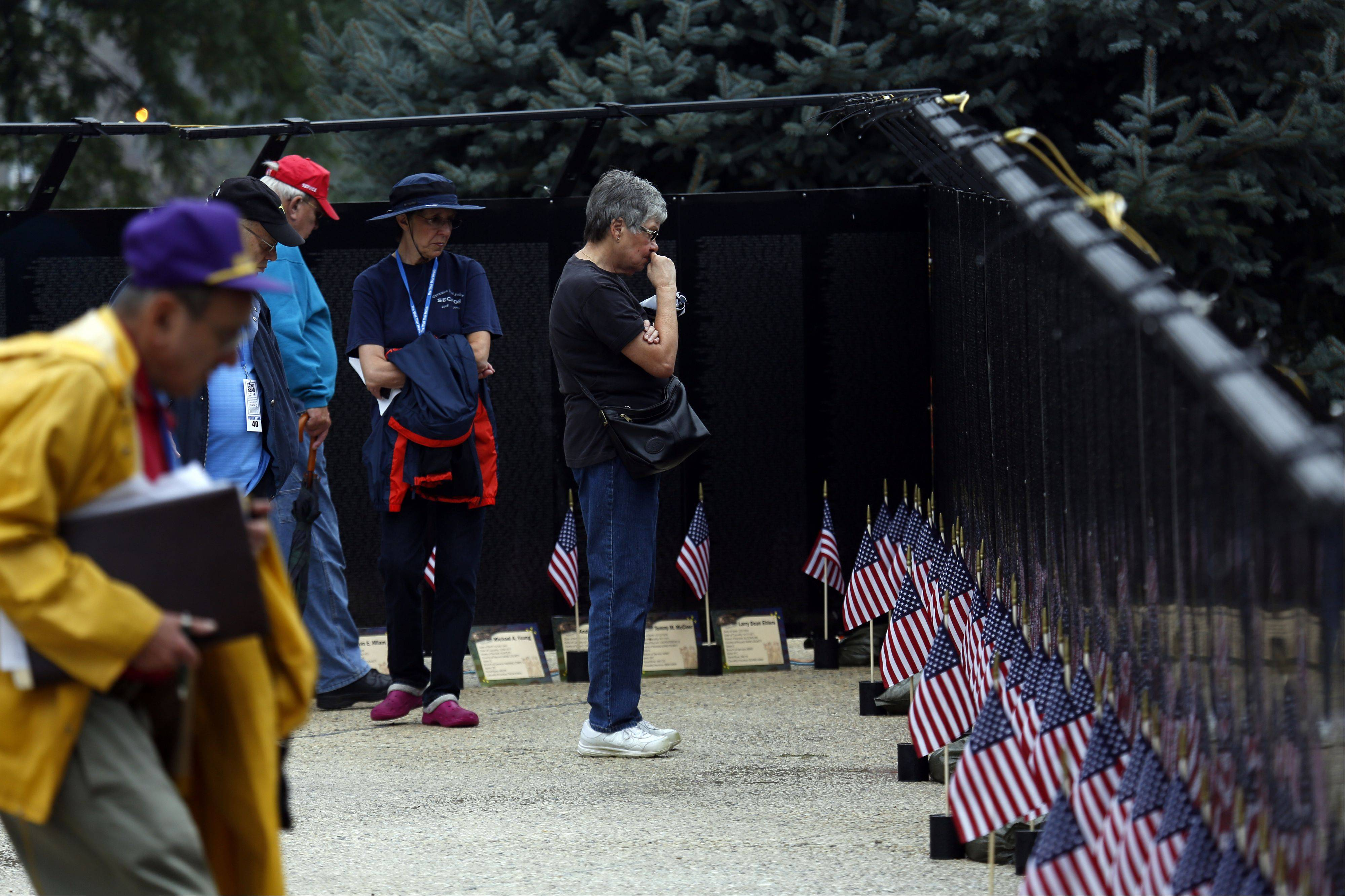 People in Elgin pause for a look at the half-size replica of the Vietnam Wall in Washington D.C.