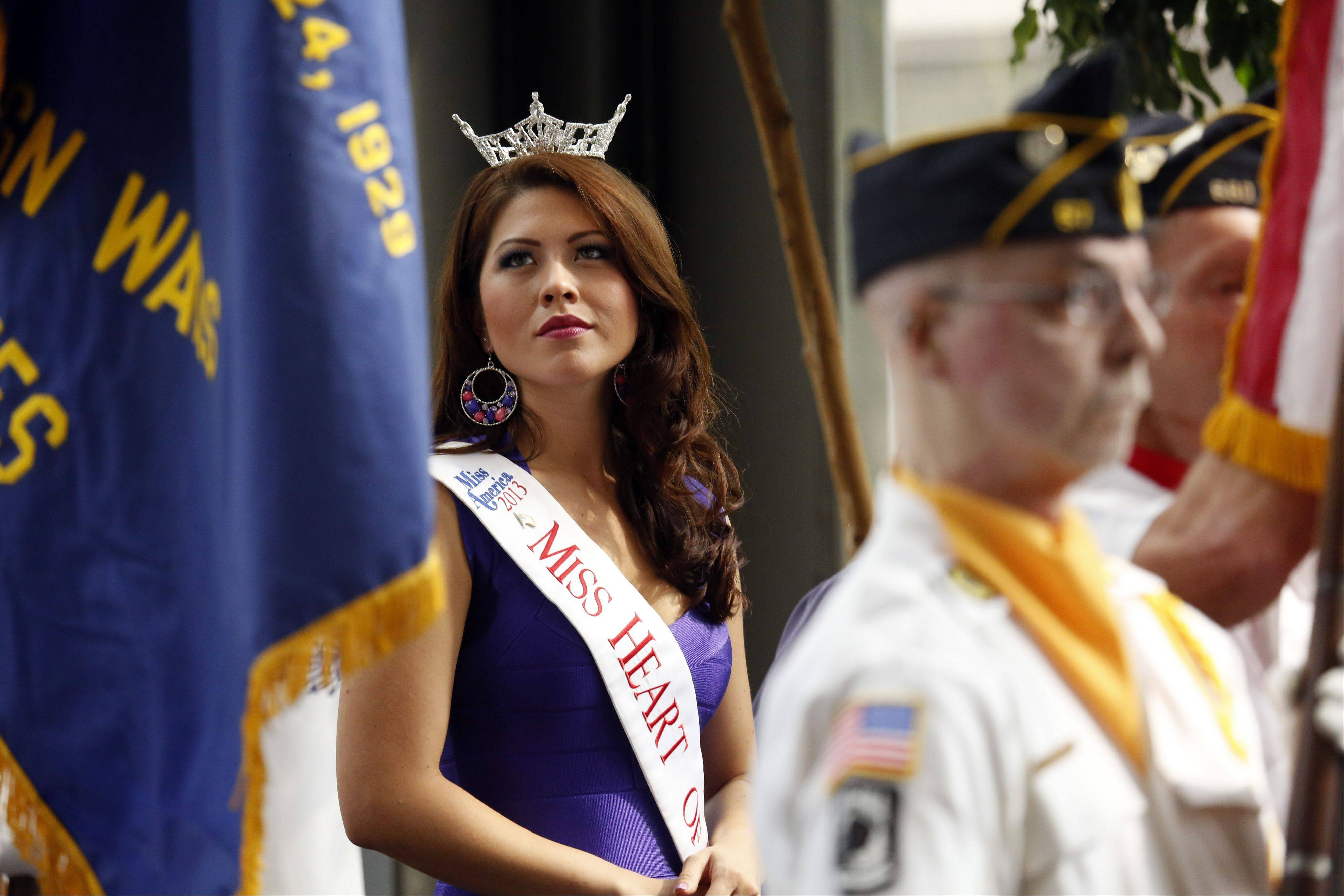 Marisa Buchheit, Miss Heart of Illinois 2013, watches as the color guard retires the colors at the end of the opening ceremony Thursday.