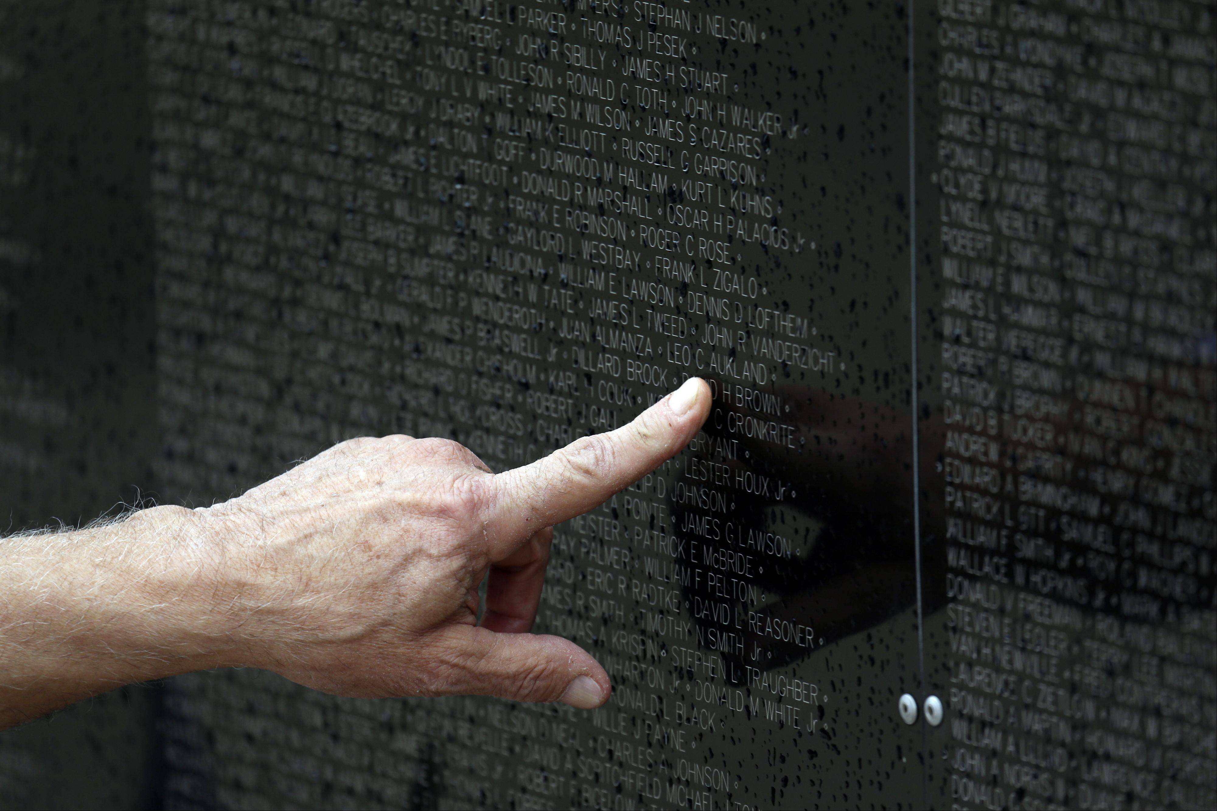 The Vietnam Wall replica contains the names of 58,249 servicemen and women who died in Vietnam.