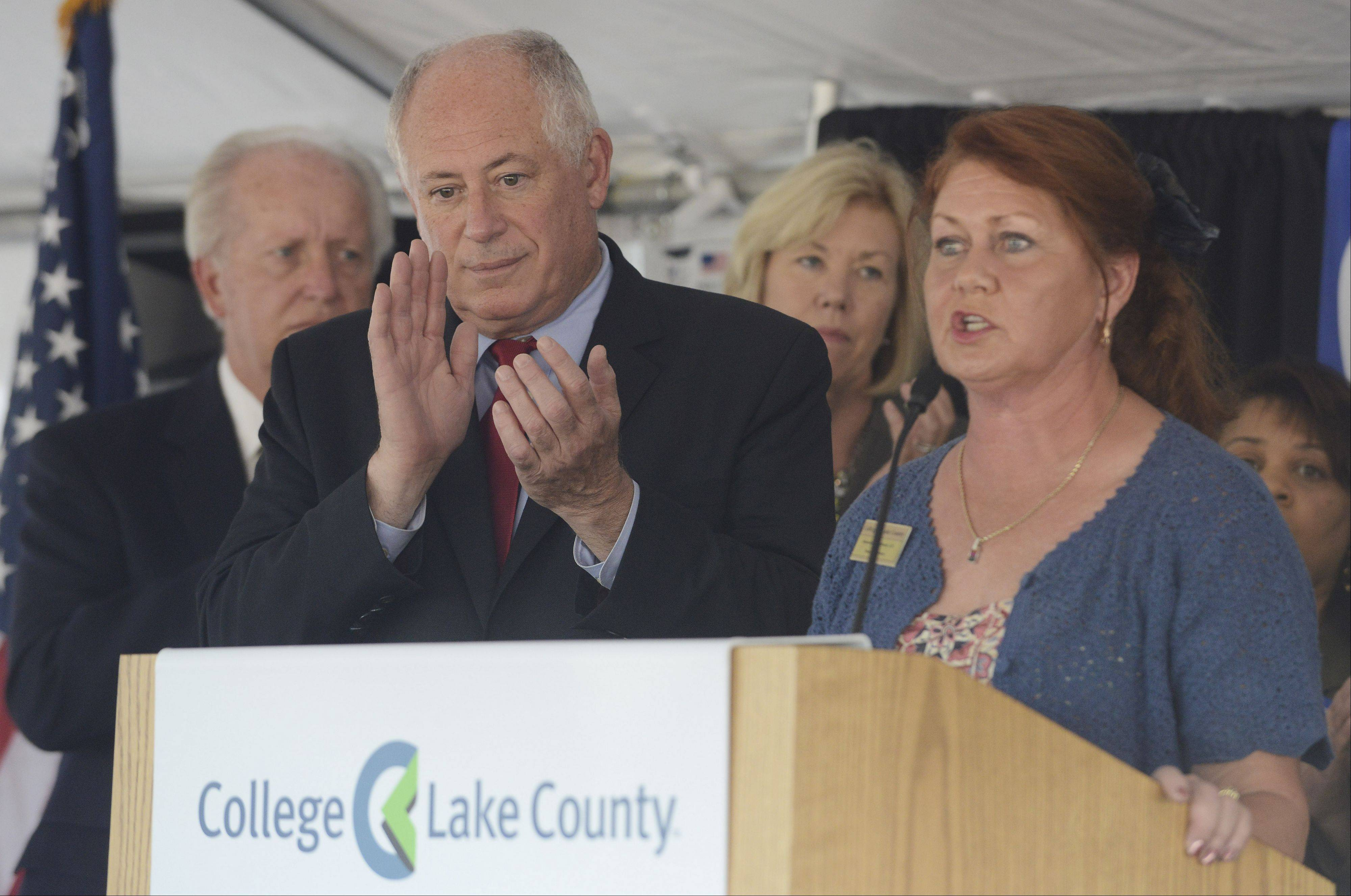 JOE LEWNARD/jlewnard@dailyherald.comGov. Pat Quinn applauds as College of Lake County board Chairman Amanda Howland speaks during a gathering Thursday on the planned expansion of the school's Lakeshore Campus in downtown Waukegan.