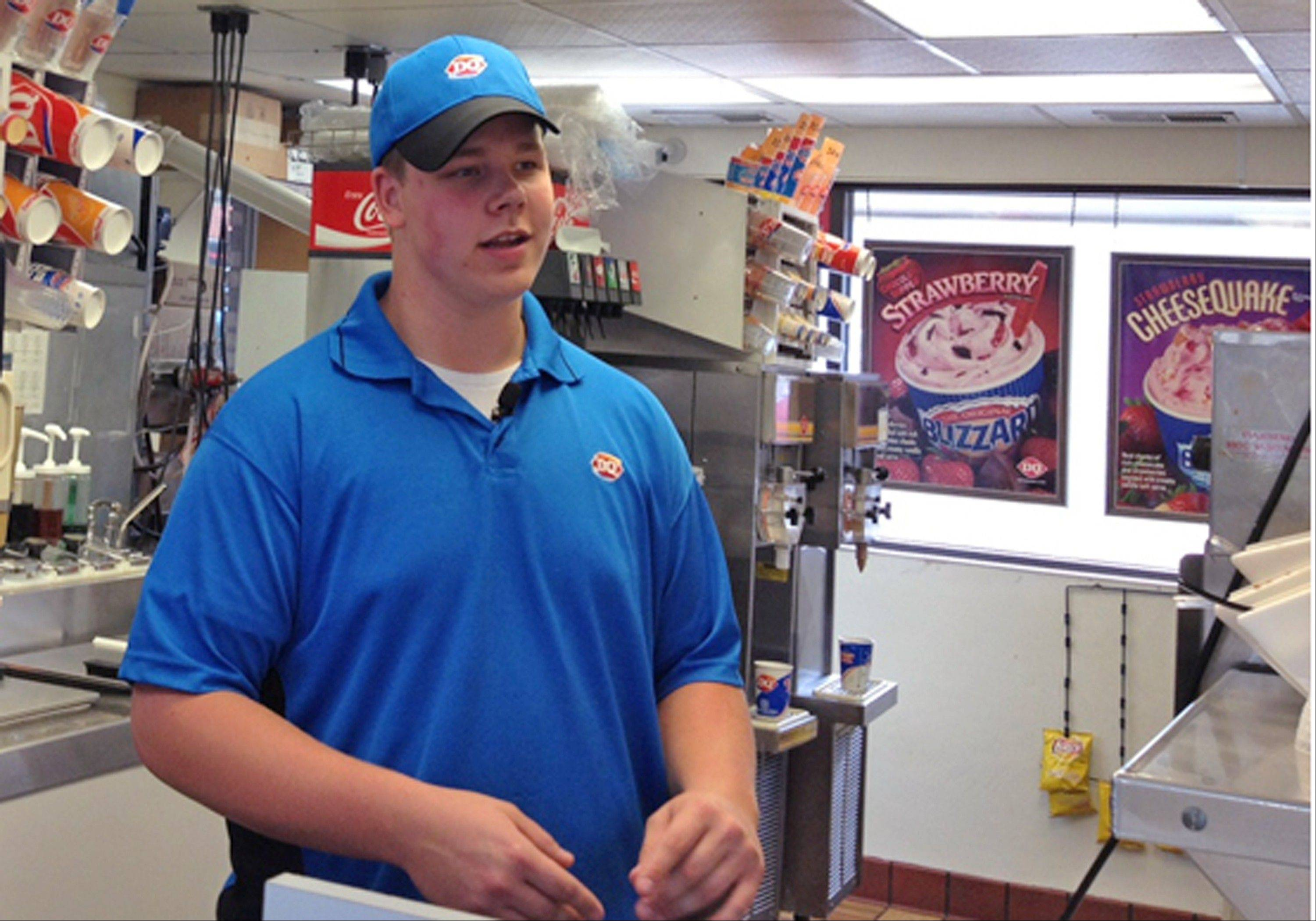 In this screen grab provided by WCCO TV is Dairy Queen employee Joey Prusak in Hopkins, Minn. Prusak is winning praise for his treatment of a visually impaired customer who unwittingly dropped a $20 bill on the floor. After another customer pocketed the bill, Prusak asked her to return it, and when she didn't, told her to leave the store. He then gave the visually impaired customer $20 from his own wallet.
