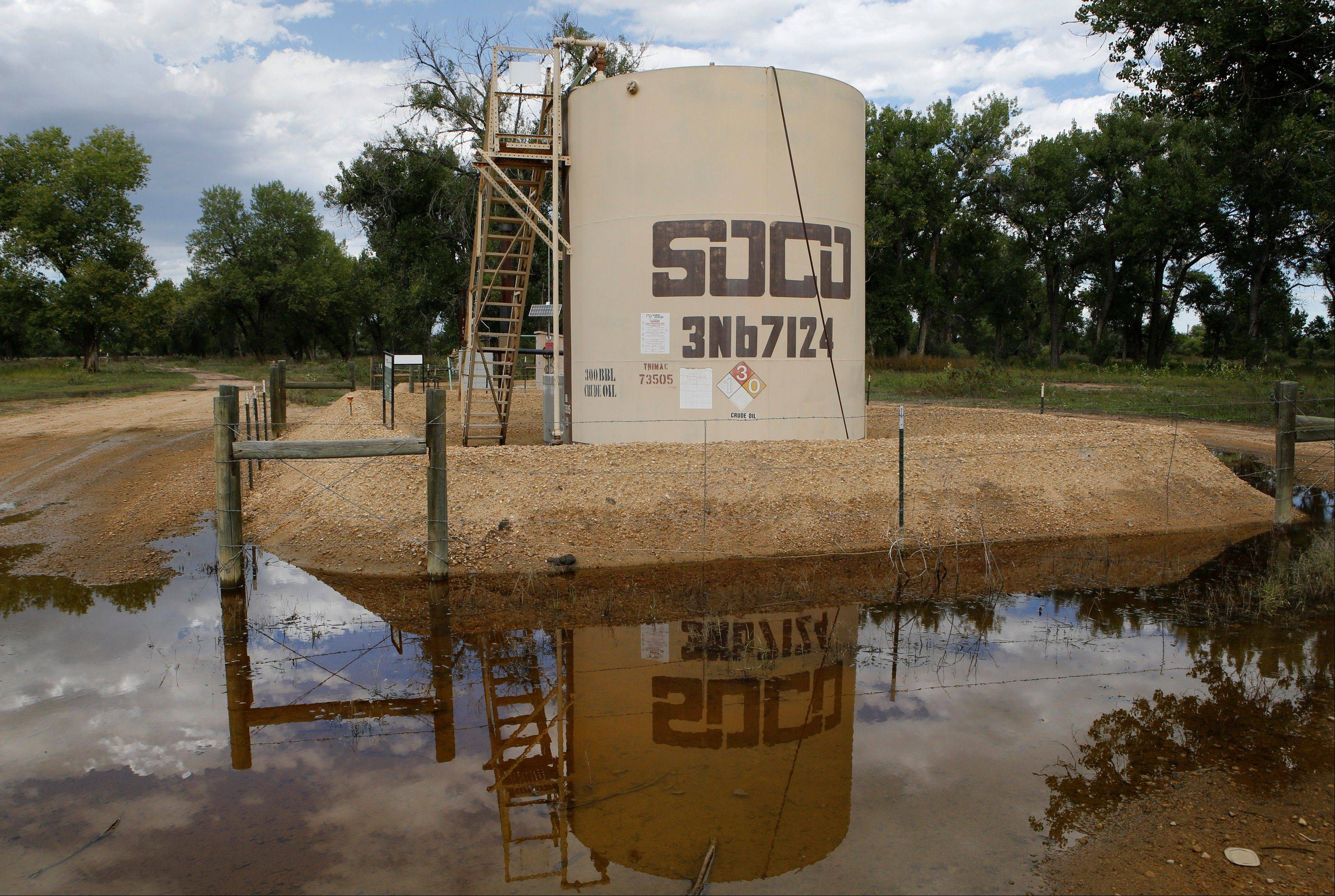 In this Wednesday, Sept. 18, 2013 photo, an oil well pump site is reflected in flood waters near Greeley, Colo. Coloradoís floods shut down hundreds of natural gas and oil wells, spilled oil from one tank and sent inspectors into the field looking for more pollution. Besides the environmental impact, flood damage to roads, railroads and other infrastructure will affect the regionís energy production for months to come.† Analysts warn that images of flooded wellheads will increase public pressure to impose restrictions on drilling techniques such as fracking.