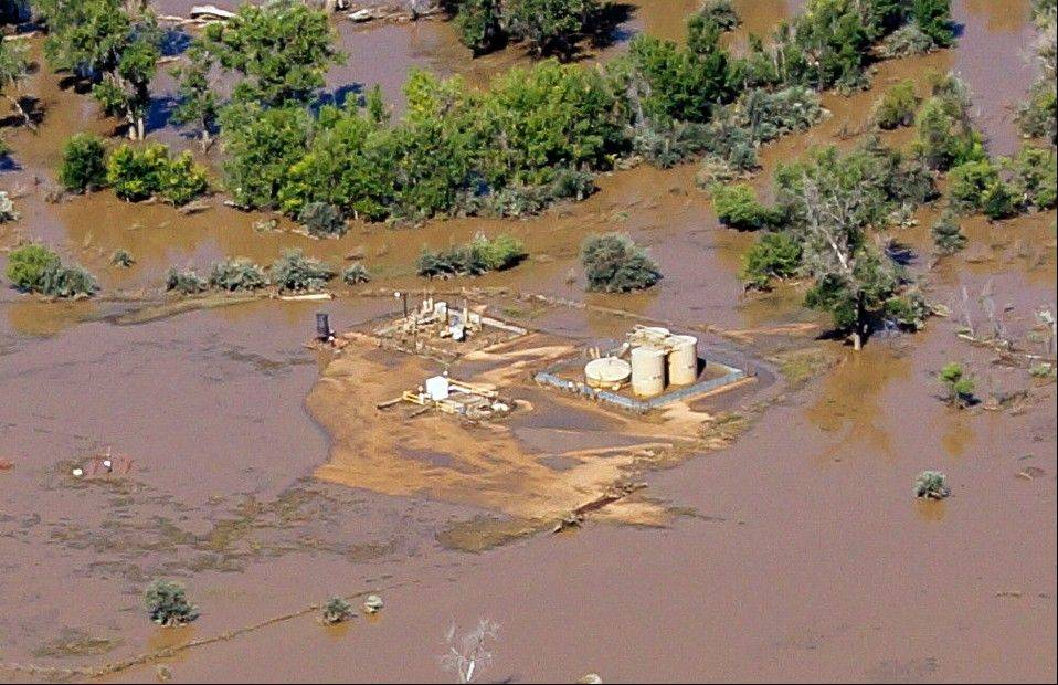 This Sept. 17, 2013 photo provided by Ecoflight shows the result of flash floods that swamped well pads and in some cases dislodged storage tanks in Weld County, Colo. Hundreds of natural gas and oil wells along with pipelines are shut down by flooding, as state and federal inspectors are gauging the damage and looking for contamination from inundated oil fields.