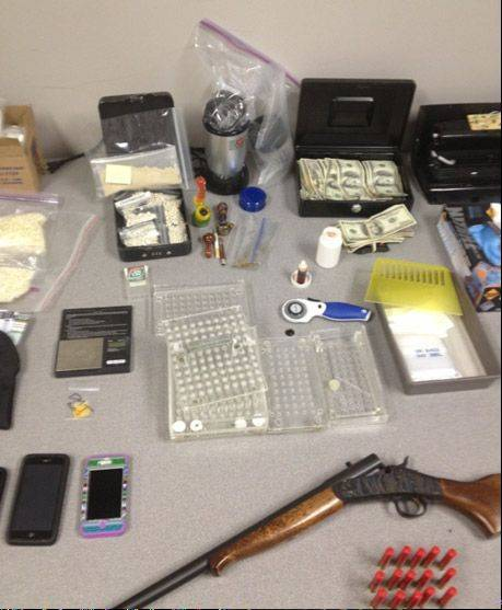 Drugs, weapons and cash confiscated by Antioch police during the arrest of Alexander and McKensie Story.
