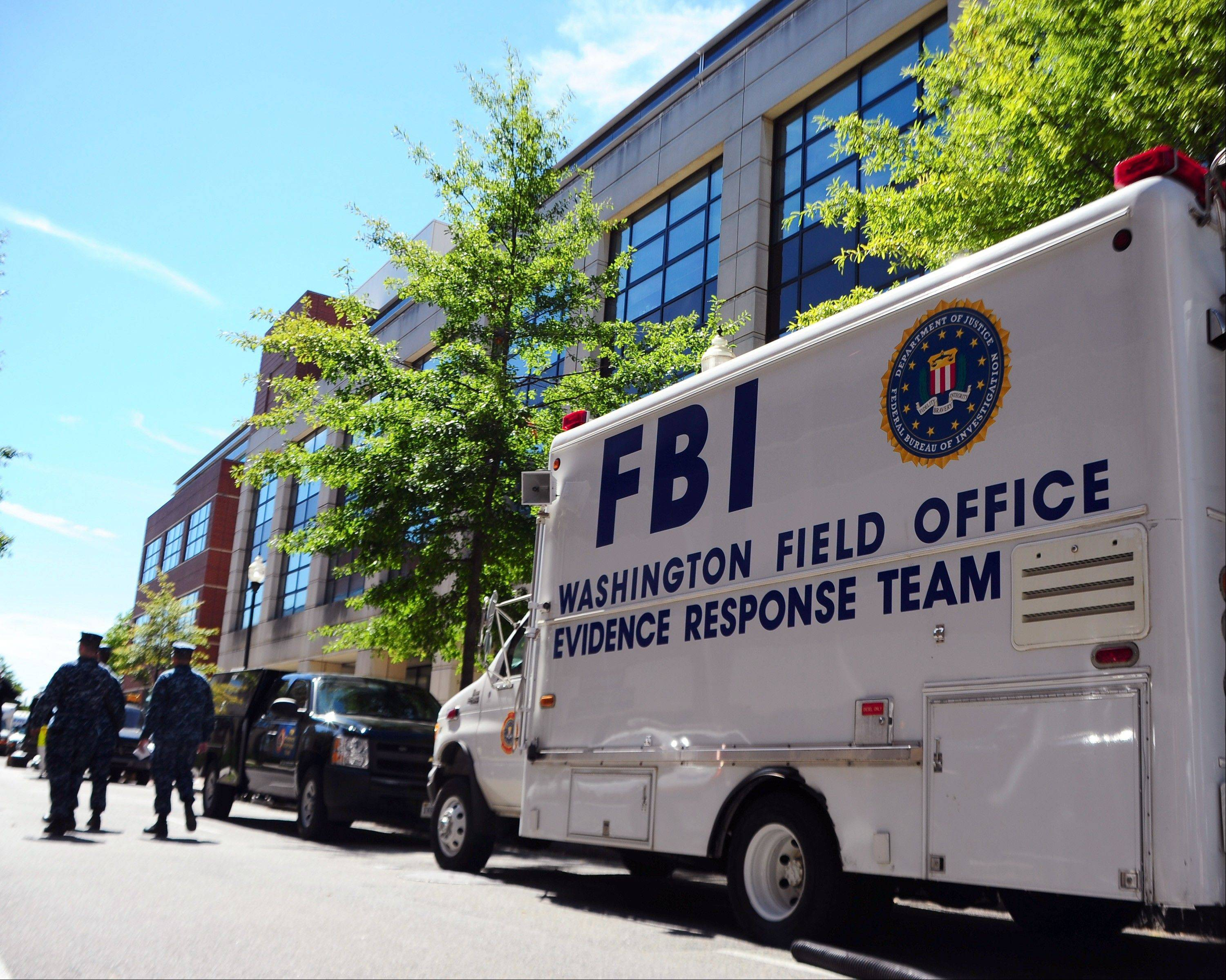 In this photo provided by the U.S. Navy, an FBI evidence response team vehicle is parked outside Building 197 at the Navy Yard in Washington as evidence is collected Wednesday, Sept. 18, 2013. A gunman killed 12 people at the base on Monday, Sept. 16, 2013.