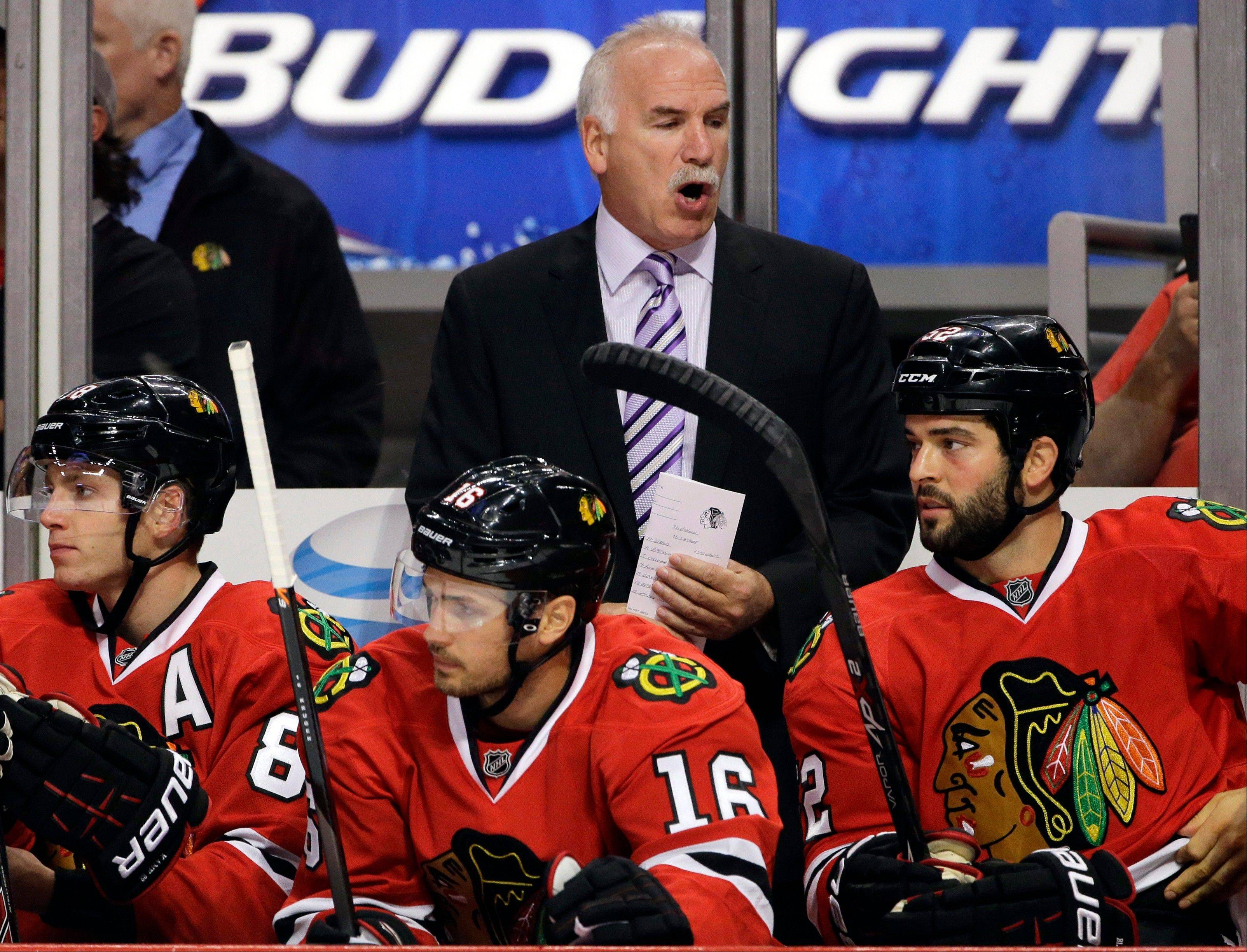 Blackhawks head coach Joel Quenneville yells at his team during the first period of an NHL preseason hockey game against the Pittsburgh Penguins in Chicago Thursday.