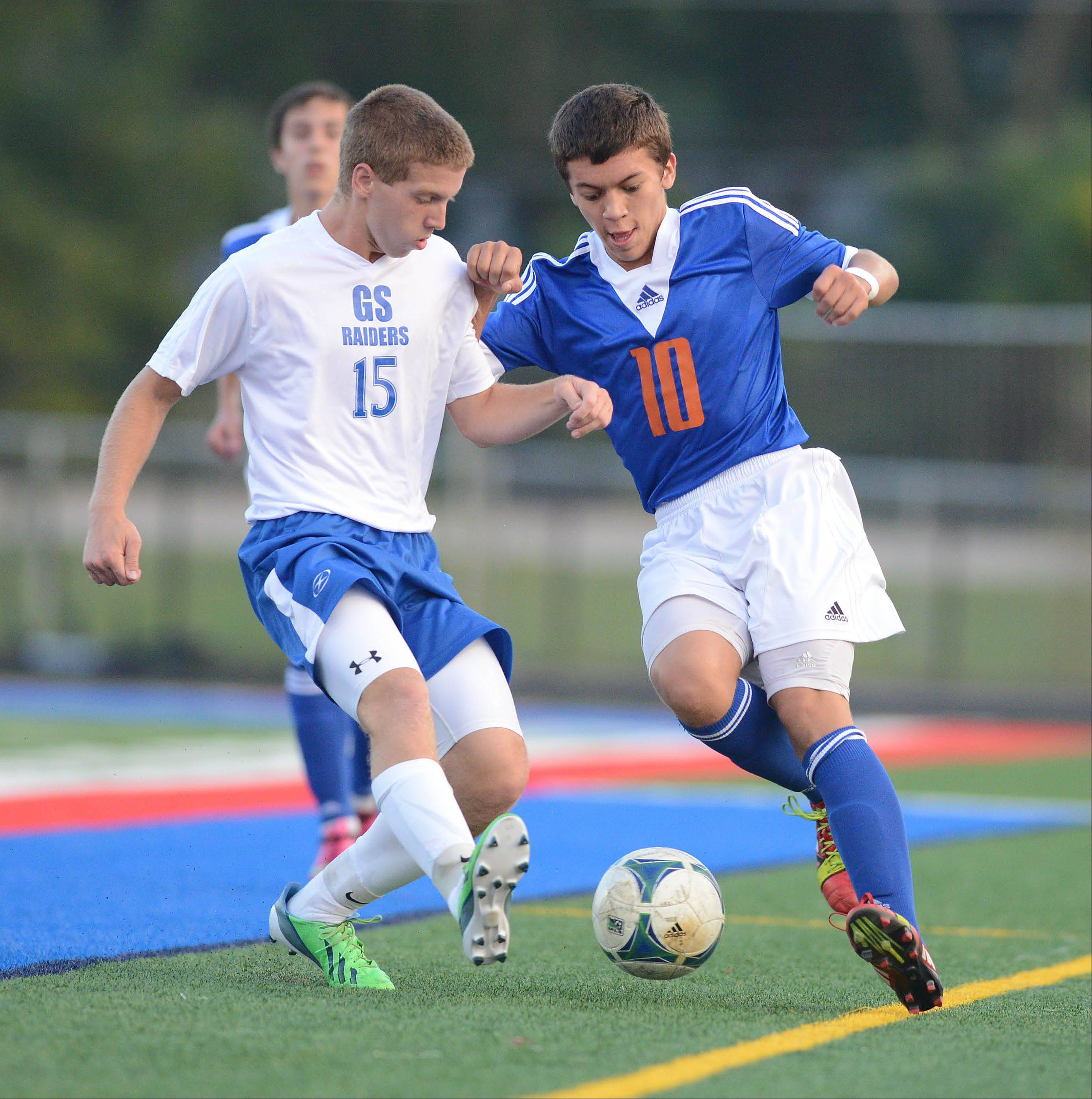 Ryan Hoffman of Glenbard South and Raul Ayala of Fenton work the ball during the Fenton at Glenbard South boys soccer game Thursday.