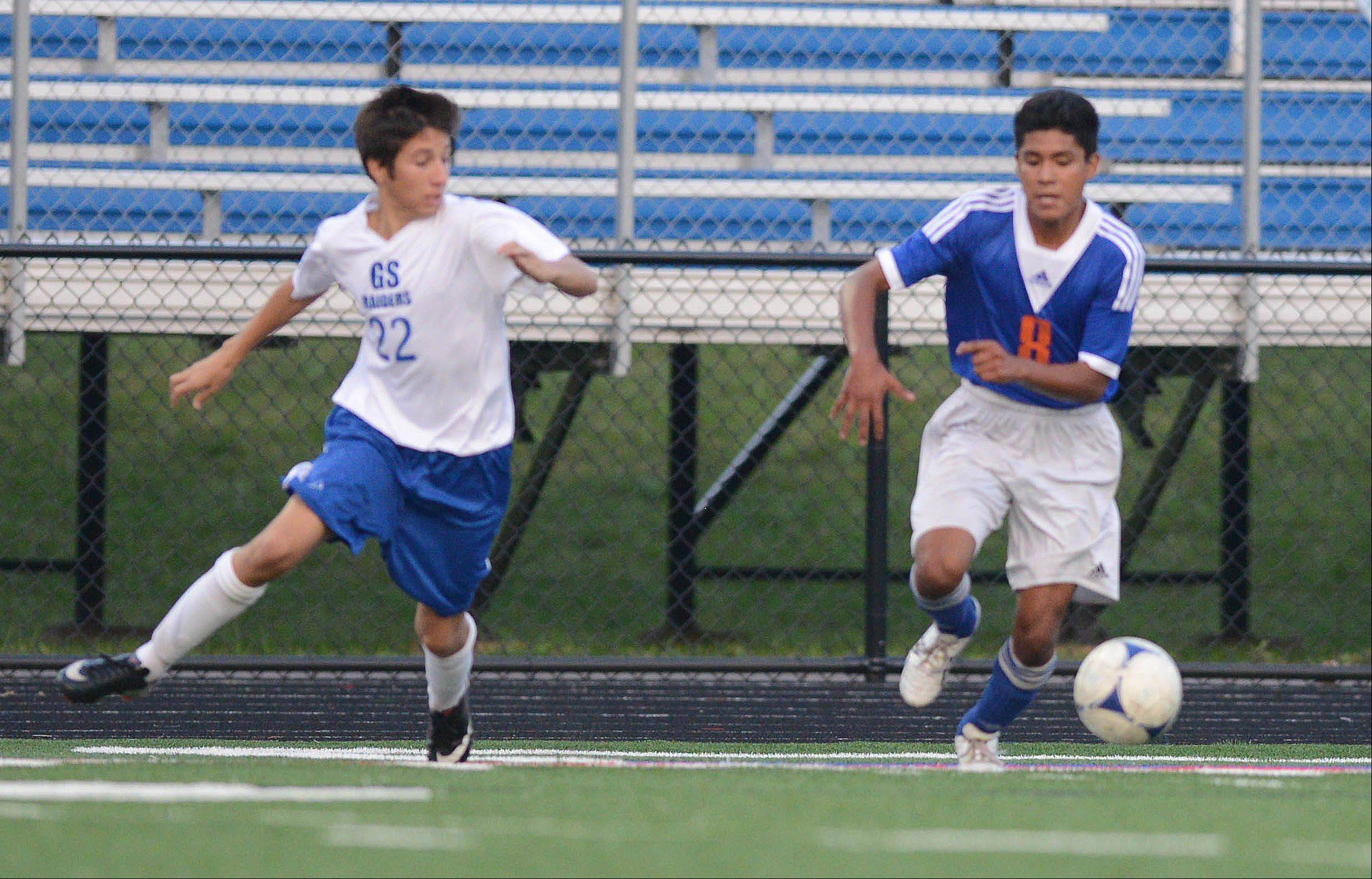 Matt Waters of Glenbard South and David Ortega of Fenton vie for the ball during the Fenton at Glenbard South boys soccer game Thursday.