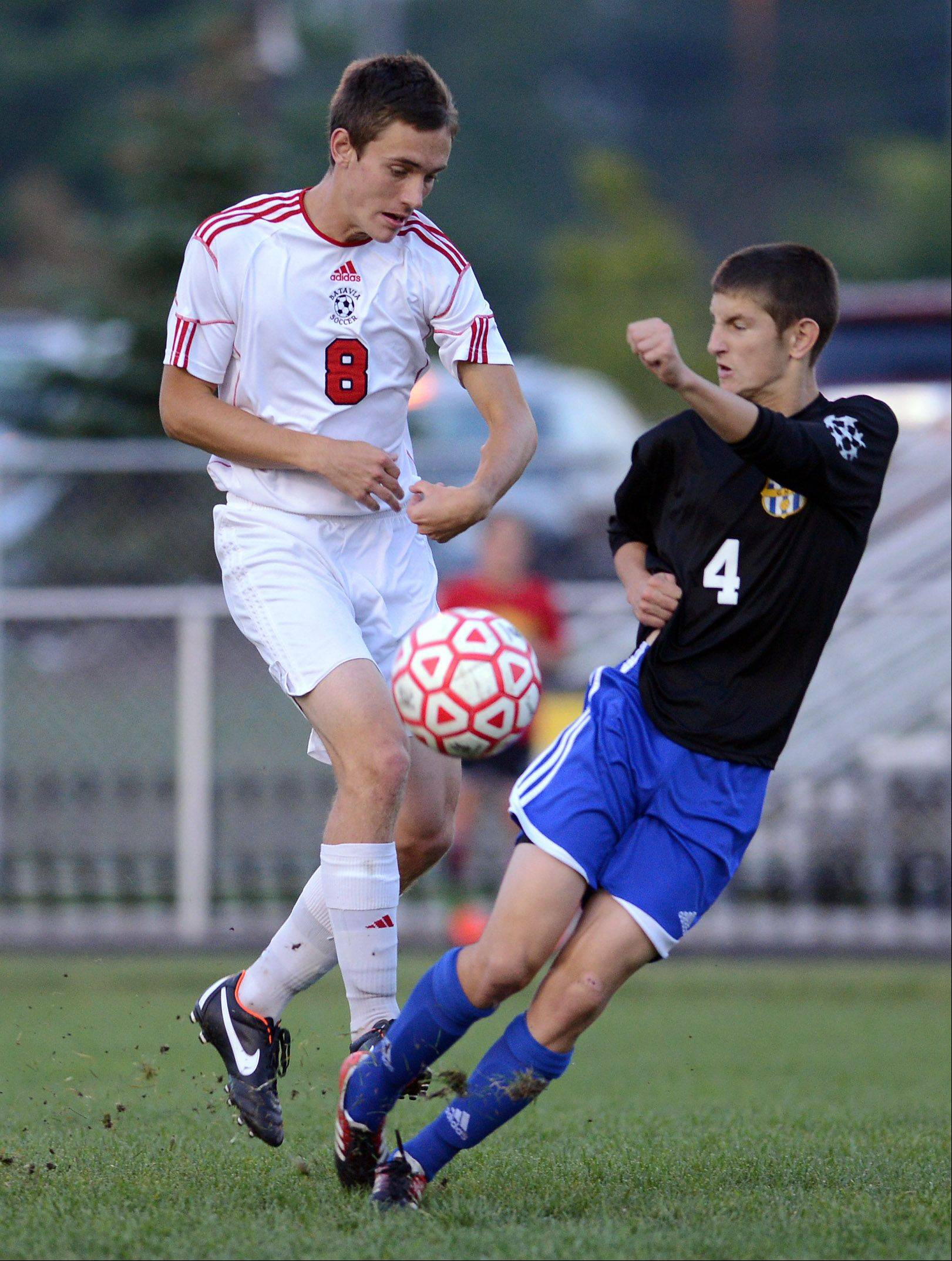 Batavia's Brendan Allen (8) is defended by Geneva's Jason Lagger (4).