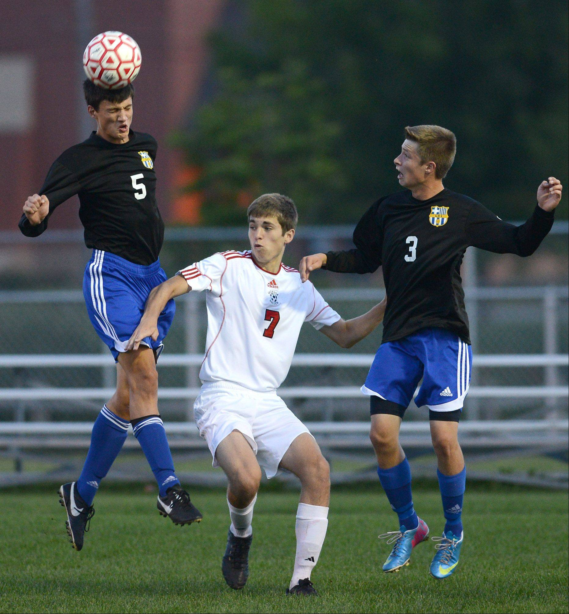 Geneva's Sam Urben (5) wins a header during Thursday's game at Batavia.